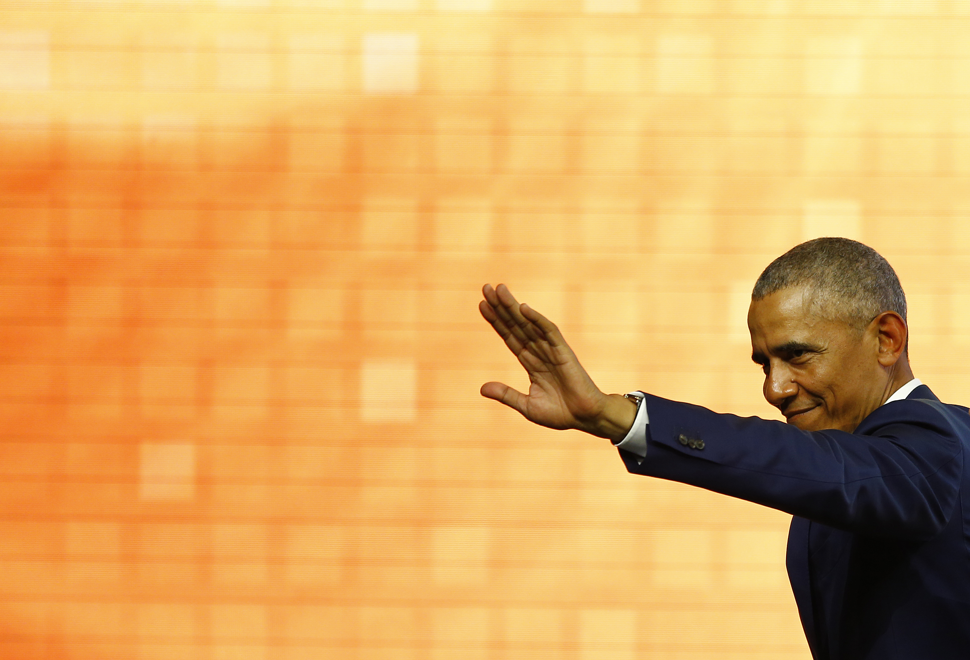 Former U.S. President Barack Obama waves during the World Travel and Tourism Council Global Summit on April 03, 2019 in Seville, Spain.