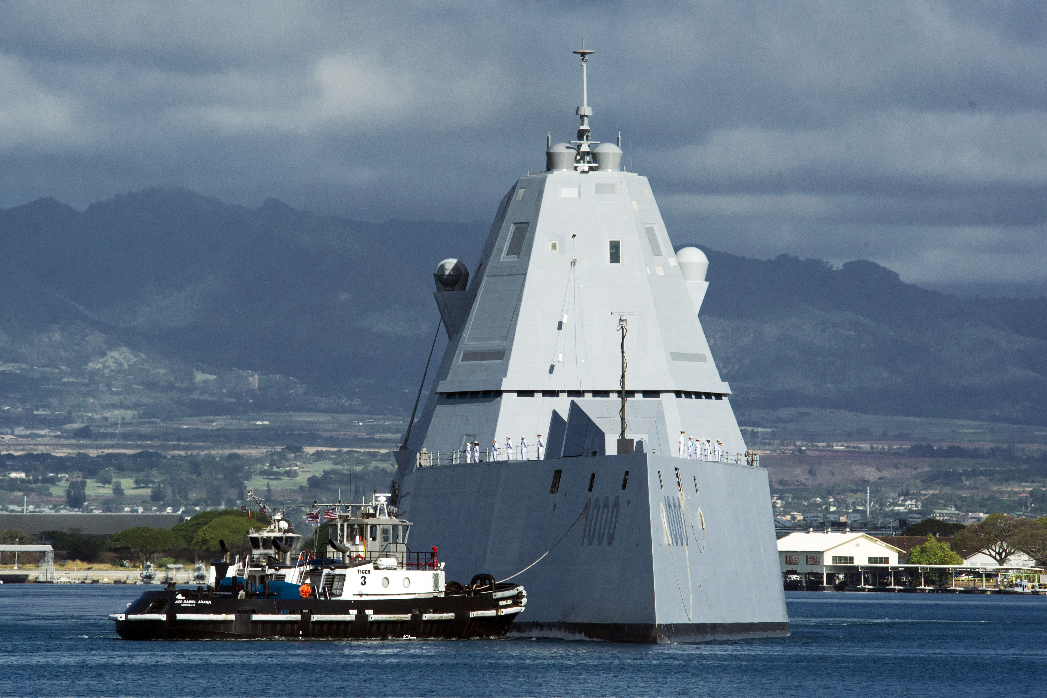 The lead ship of the U.S. Navy's newest class of guided-missile destroyers, the USS Zumwalt (DDG-1000), is assisted by a tugboat at Joint Base Pearl Harbor-Hickam in Honolulu on April 2, 2019.