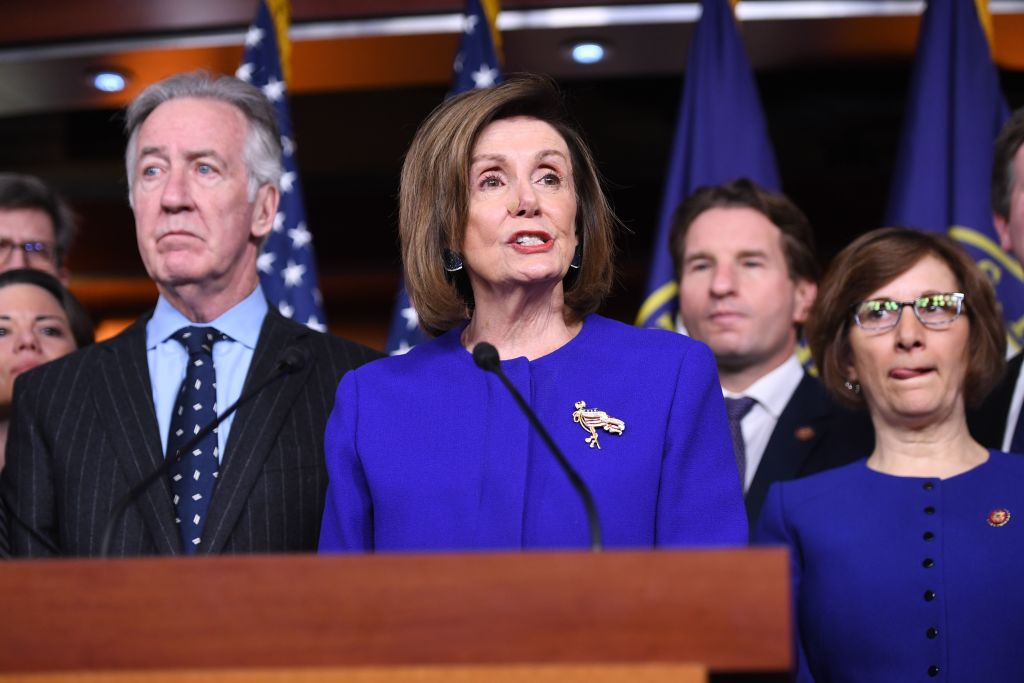 Speaker of the House Nancy Pelosi and House Ways and Means Committee Chairman Richard Neal, Democrat of Massachusetts, speaks about the US - Mexico - Canada Agreement, known as the USMCA, on Capitol Hill in Washington, DC, on December 10, 2019.