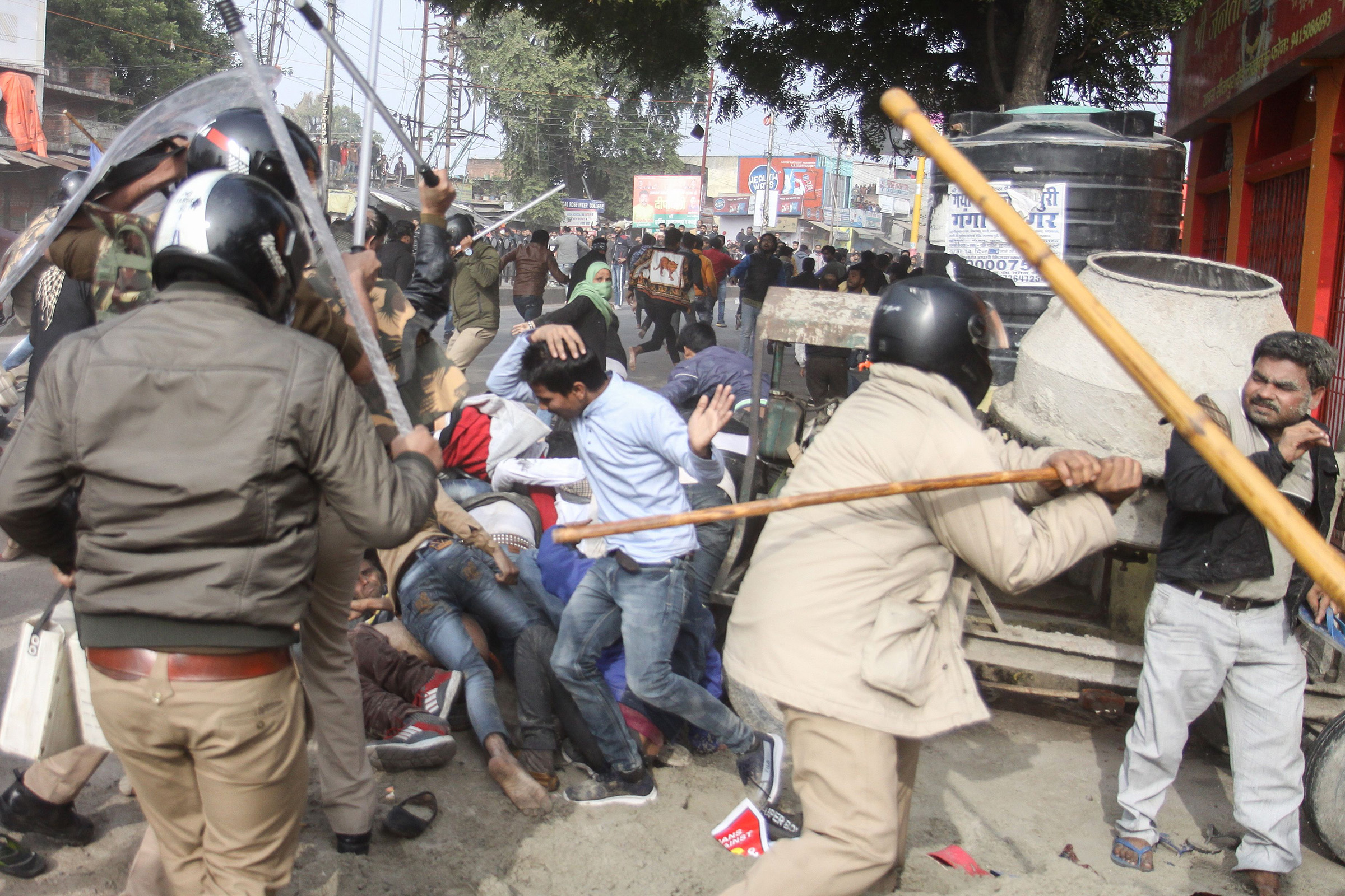 Police beat protesters with sticks during a demonstration against India's new citizenship law in Lucknow, Uttar Pradesh, India on Dec. 19, 2019.