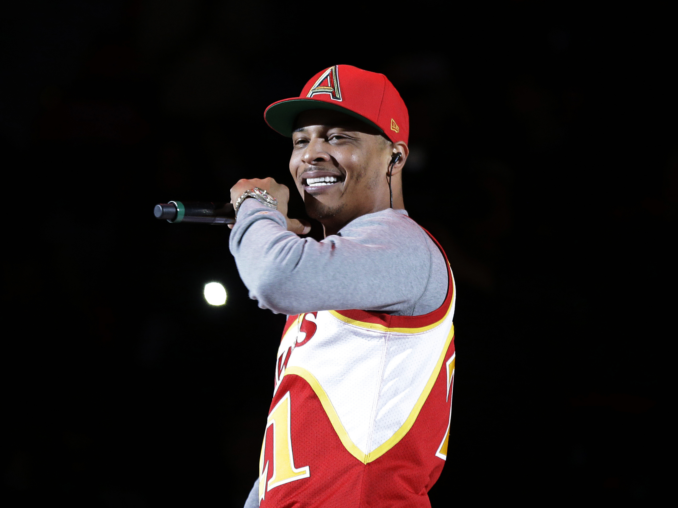FILE - In this Nov. 1, 2014, file photo, rapper T.I. performs before the start of an NBA basketball game between the Indiana Pacers and the Atlanta Hawks in Atlanta. A New York lawmaker wants to ban tests aimed at determining virginity in response to remarks by the rapper earlier this month in which he said he has a gynecologist check his daughter's hymen annually.