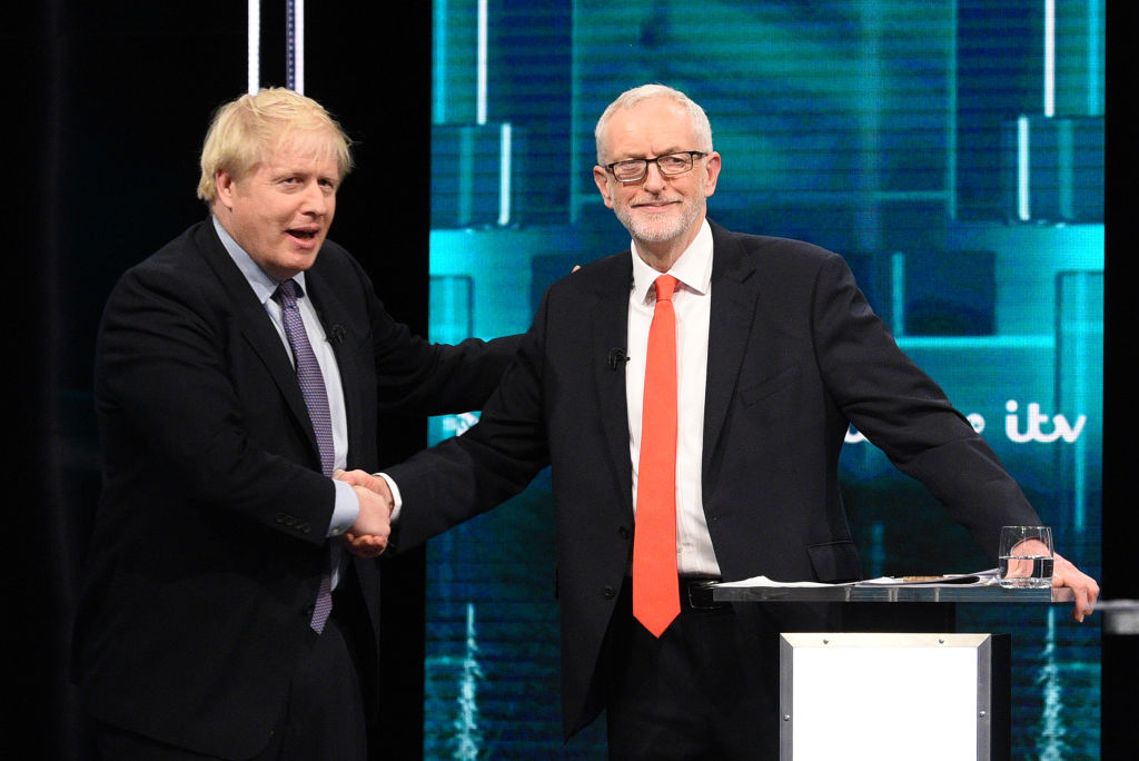 n this handout image supplied by ITV, Prime Minister Boris Johnson and Leader of the Labour Party Jeremy Corbyn shake hands during the ITV Leaders Debate at Media Centre on November 19, 2019 in Salford, England.