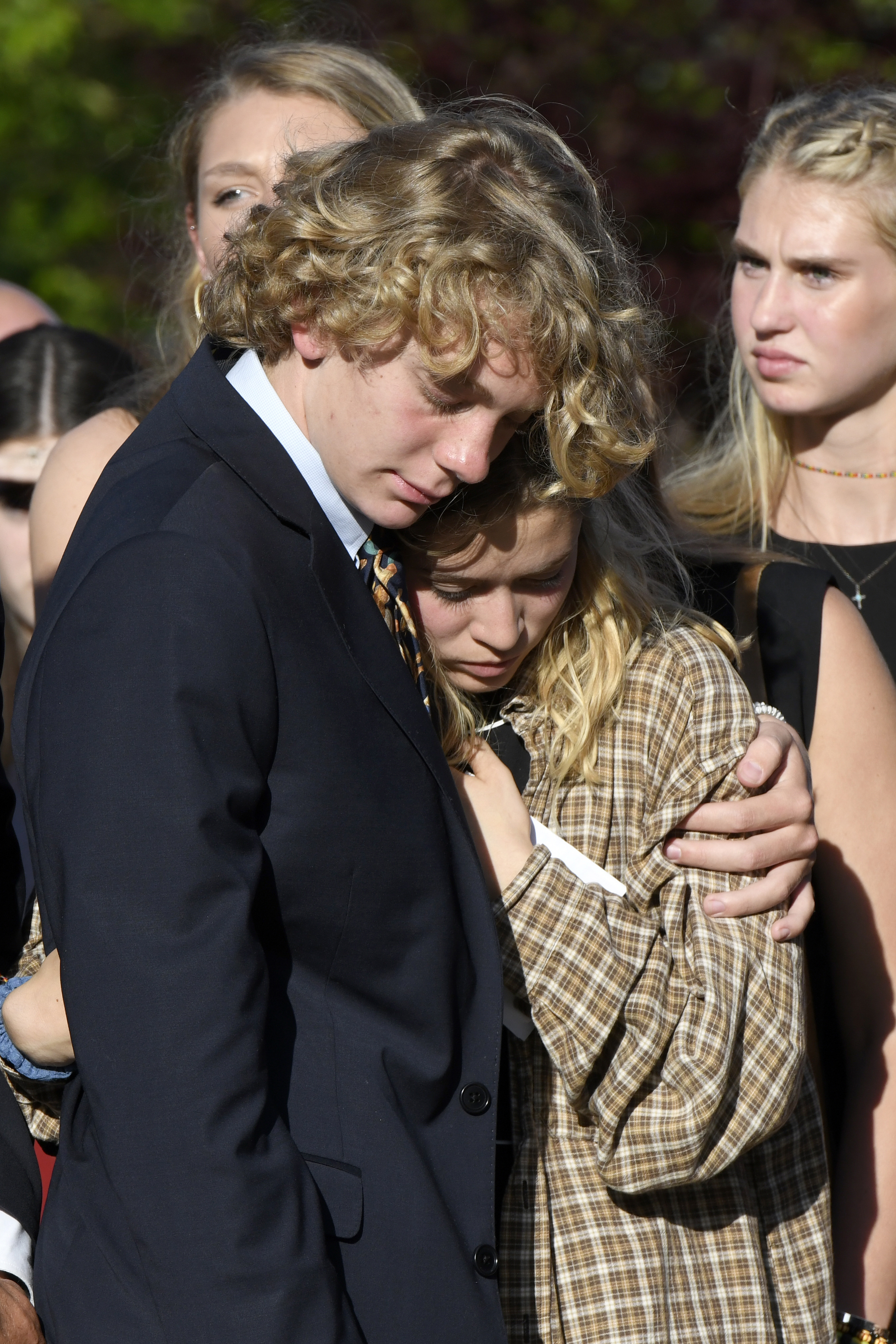 Riley Howell's brother, Teddy Howell, and girlfriend, Lauren Westmoreland, comfort each other after a memorial service f in Lake Junaluska, N.C., on May 5, 2019.
