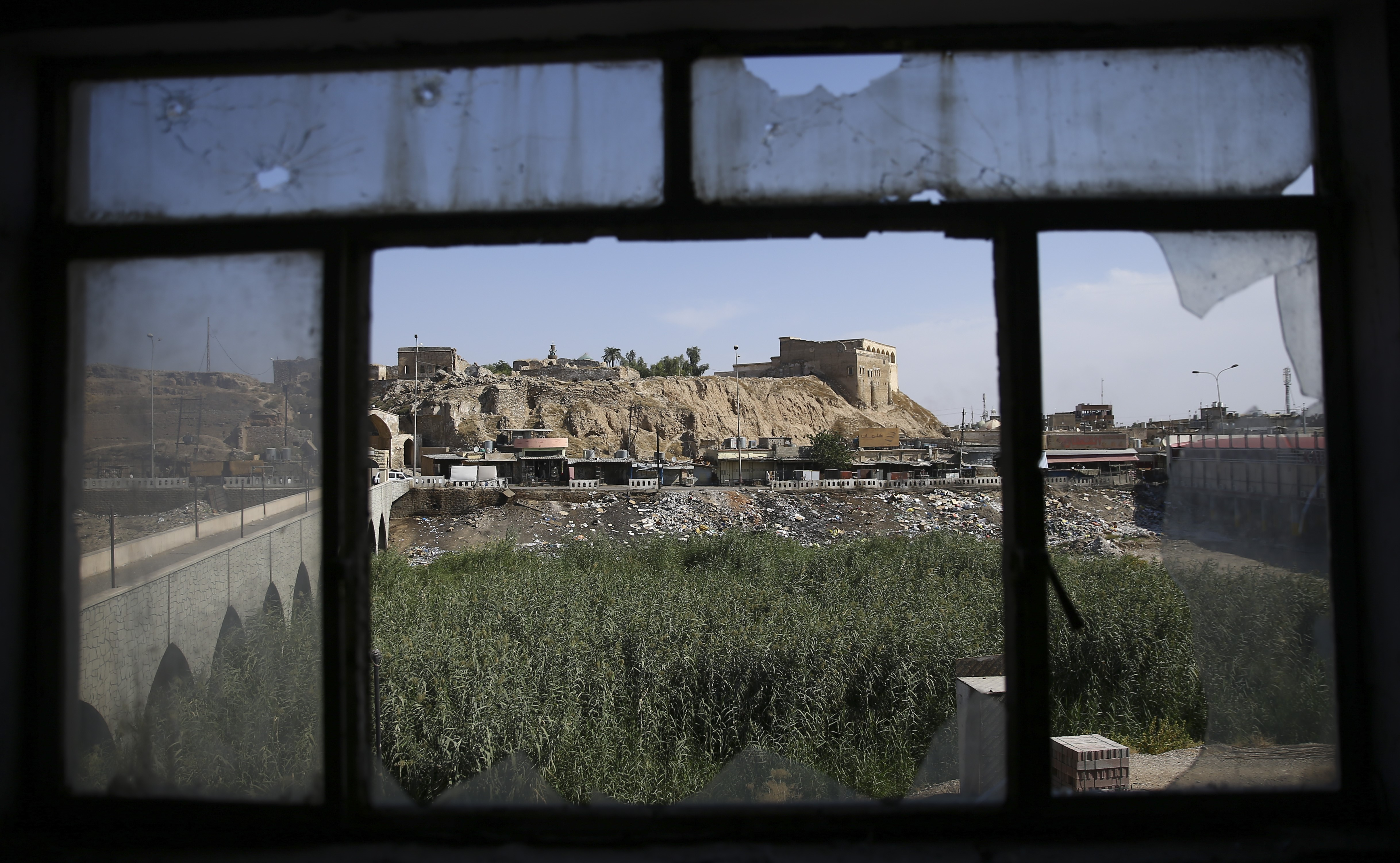 A view of Kirkuk through the broken window of Jihad Hotel, previously used as a base by Daesh terrorists, in Kirkuk, Iraq on Oct. 22, 2016.