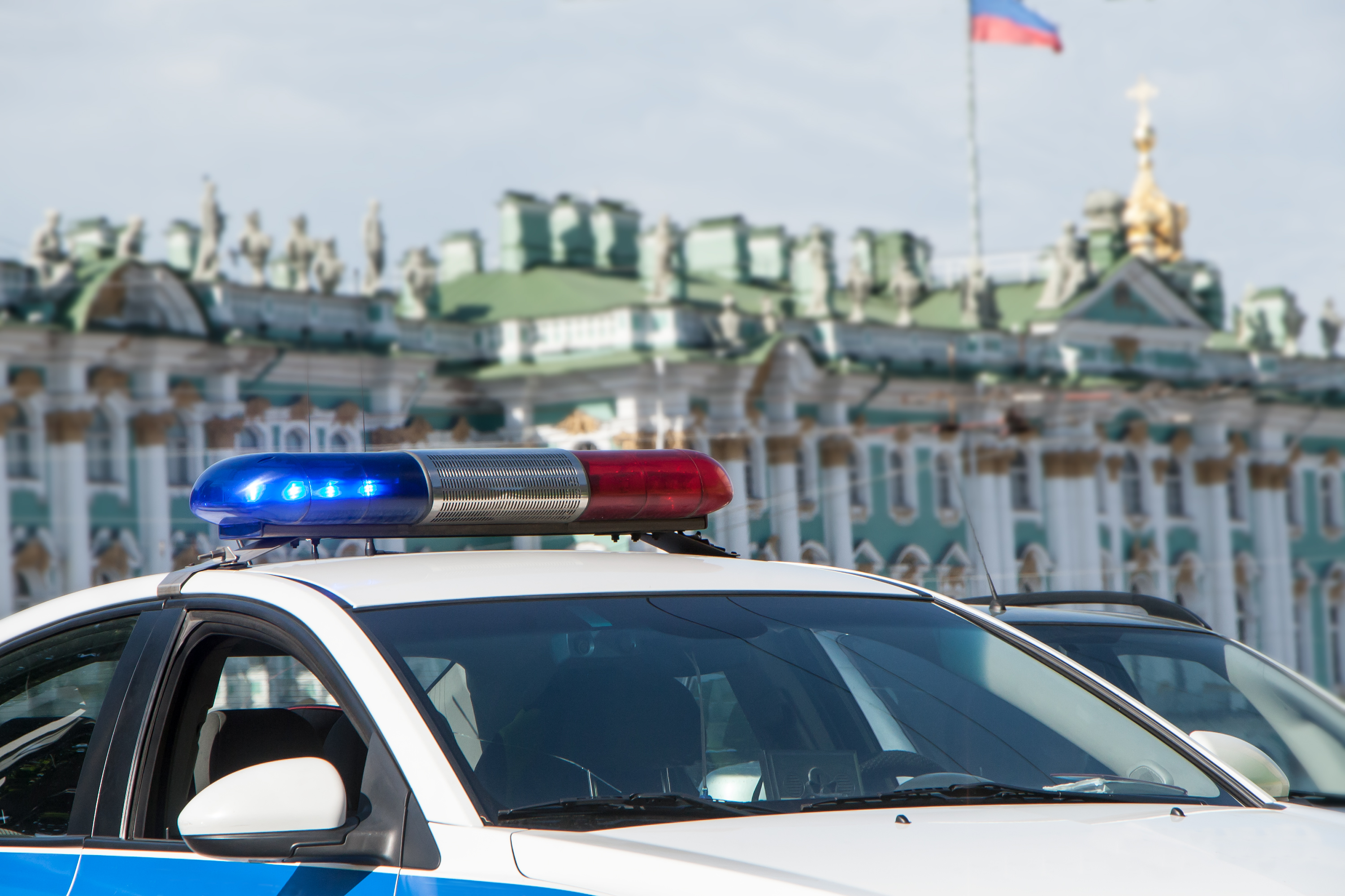 Police cars in front of the State Hermitage Museum in St. Petersburg, Russia.