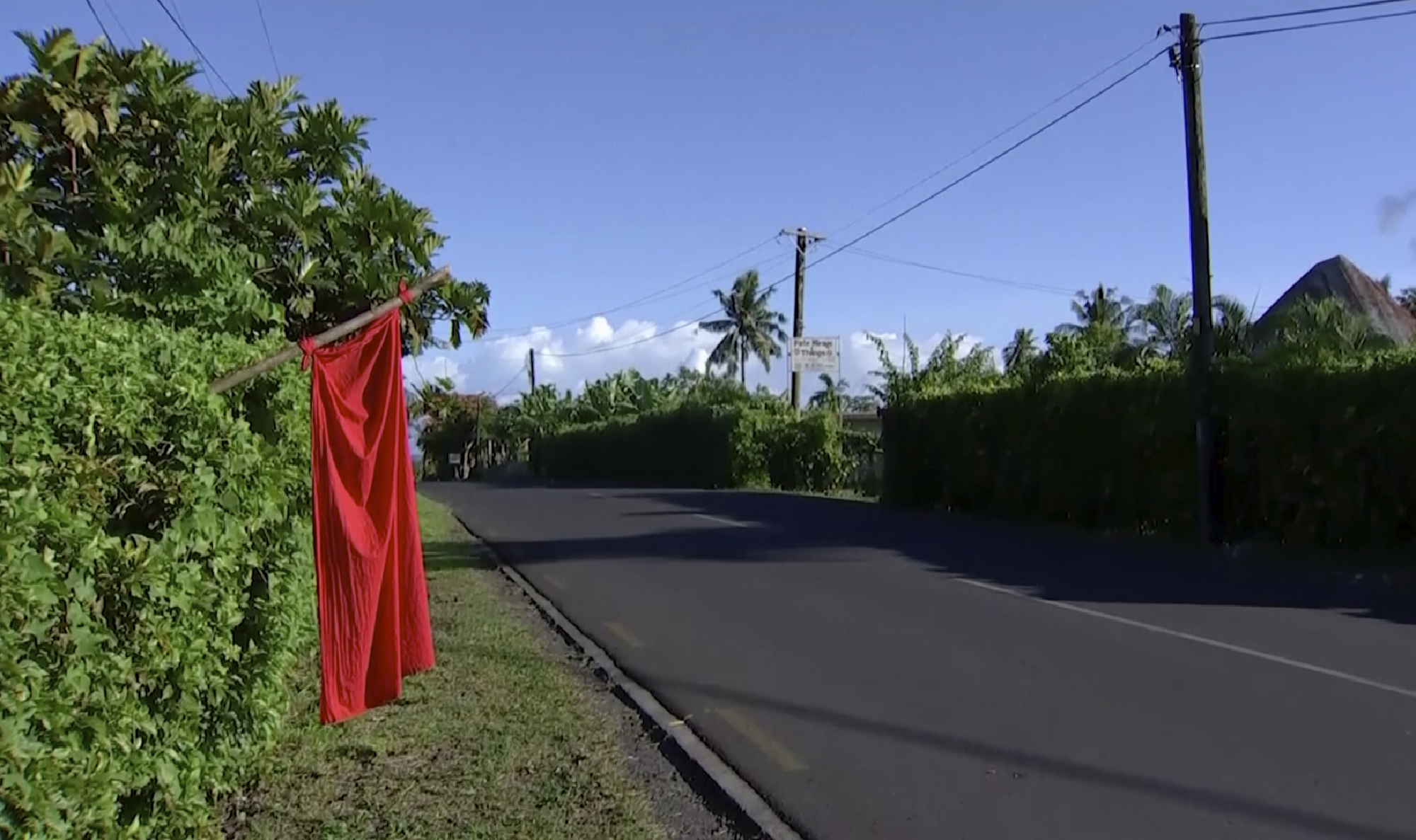 In this image from video, a red flags hangs outside homes of residents who have not been vaccinated in Apia, Samo on Dec. 5, 2019.