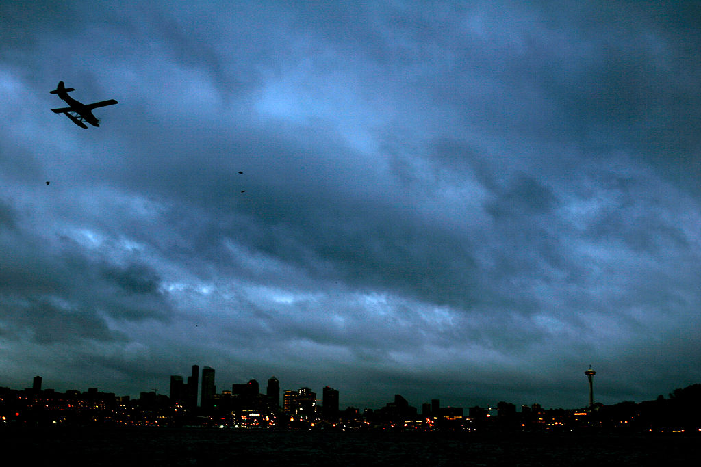 Clouds cover the sky while it rains as a sea plane approaches Lake Union for a landing in Seattle on Jan. 11, 2006.