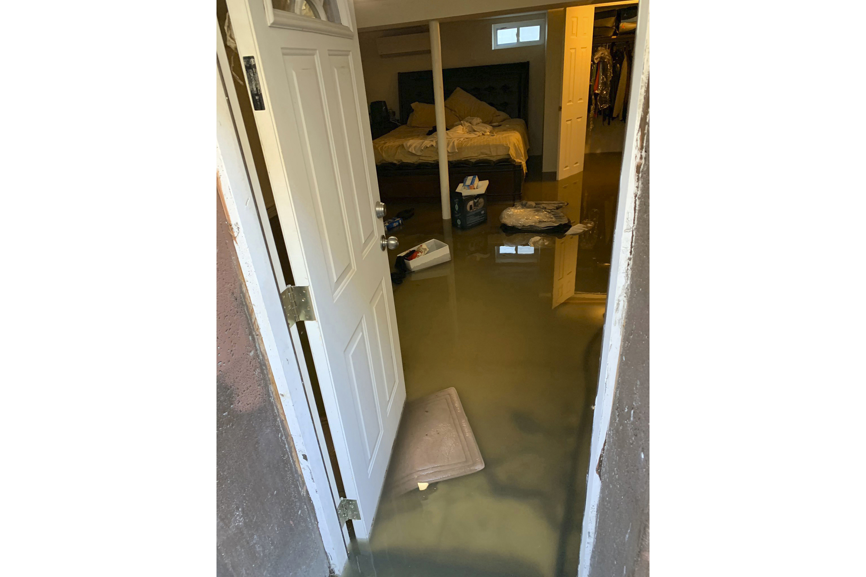 In this photo provided by Cynthia McKenzie is sewage backup that flooded her home on Nov. 30, 2019, in the Jamaica, Queens section of New York. Officials say a water condition is causing human waste to back up into several hundred homes in the area there.
