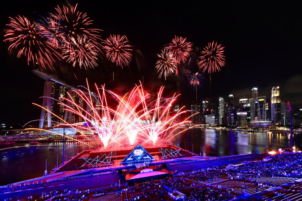 Singapore awaits 2020 with curtain-raiser fireworks by Star Island as revellers join in the biggest countdown celebration at Marina Bay on December 31, 2019 in Singapore.