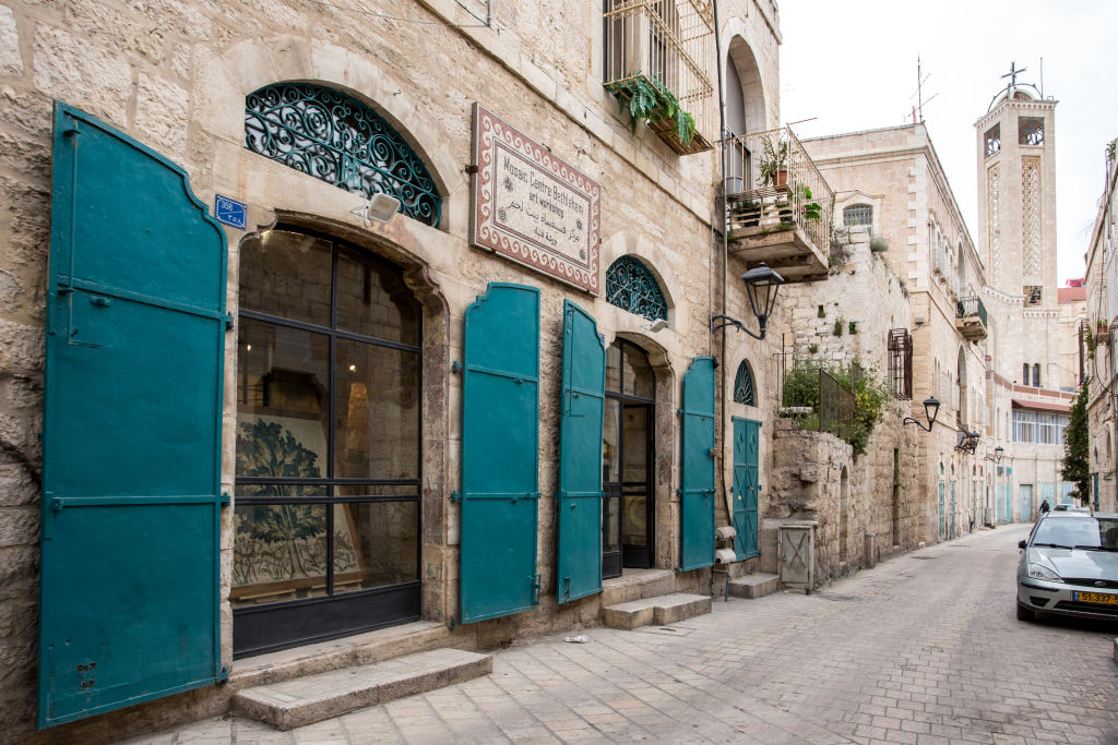 Main doors of Mosaic centre in Bethlehem and a view of the Star Street in Bethlehem, West Bank on April 6, 2019.