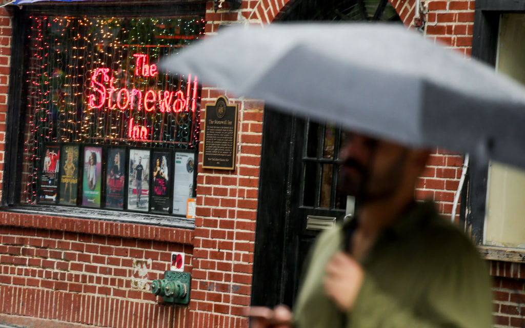 A man walks by the historical landmark The Stonewall Inn on June 18, 2019, in New York, N.Y.