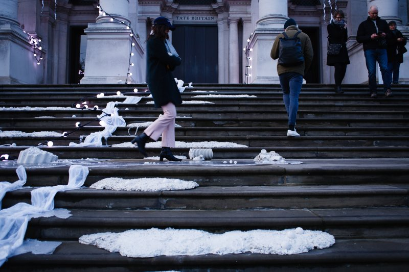 People walk across the light-and-sound installation 'The Depth Of Darkness The Return Of The Light', by artist Anne Hardy, on the steps of the Tate Britain art gallery in London, England, on November 30, 2019. Hardy's piece, unveiled today as the gallery's 2019 Winter Commission, is intended to make the building resemble a 'marooned temple'. A thundery soundtrack accompanies the physical objects fixed to the steps and masonry of the front of the gallery. The installation will remain in place until January 26 next year. (Photo by )