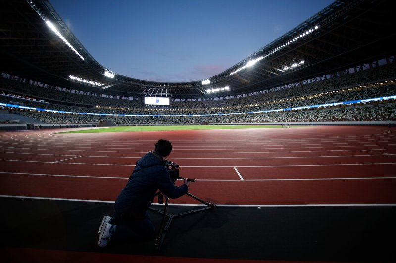 A videographer records the field at the new National Stadium on Dec. 15, 2019, in Tokyo.