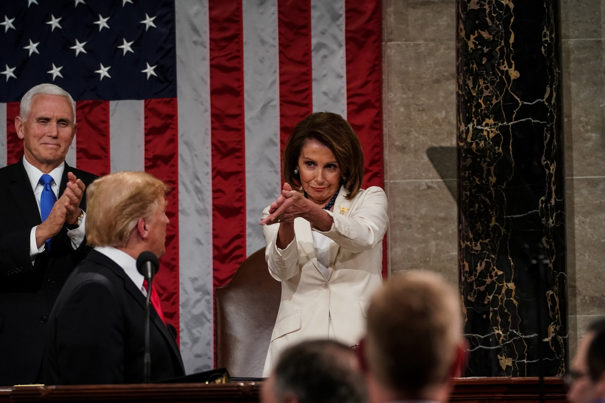 """House Speaker Nancy Pelosi claps during President Trump's State of the Union address in Washington, D.C., on Feb. 5. Trump had just delivered this line: """"We must reject the politics of revenge, resistance and retribution and embrace the boundless potential of cooperation, compromise and the common good."""" The message of bipartisan cooperation was one that the Democratic leader could get behind, she told reporters who asked about the viral image the next day, and did so with her clap."""
