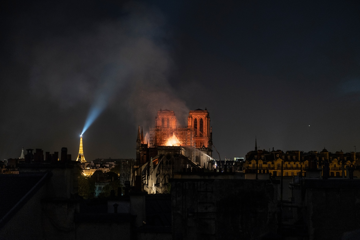 Smoke and flames rise from Notre Dame in Paris on April 15.
