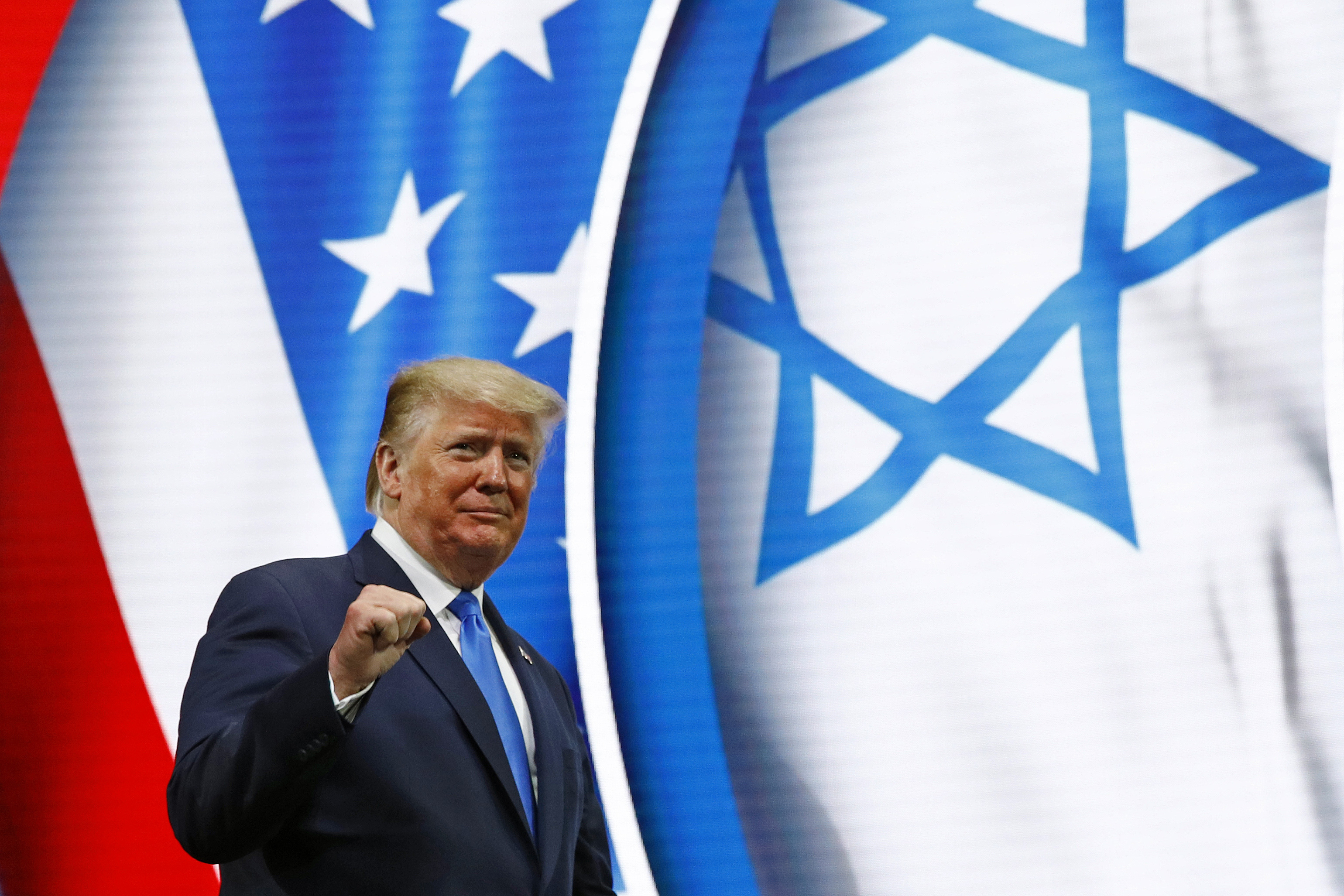 President Donald Trump walks onstage to speak at the Israeli American Council National Summit in Hollywood, Fla., on Dec. 7, 2019.