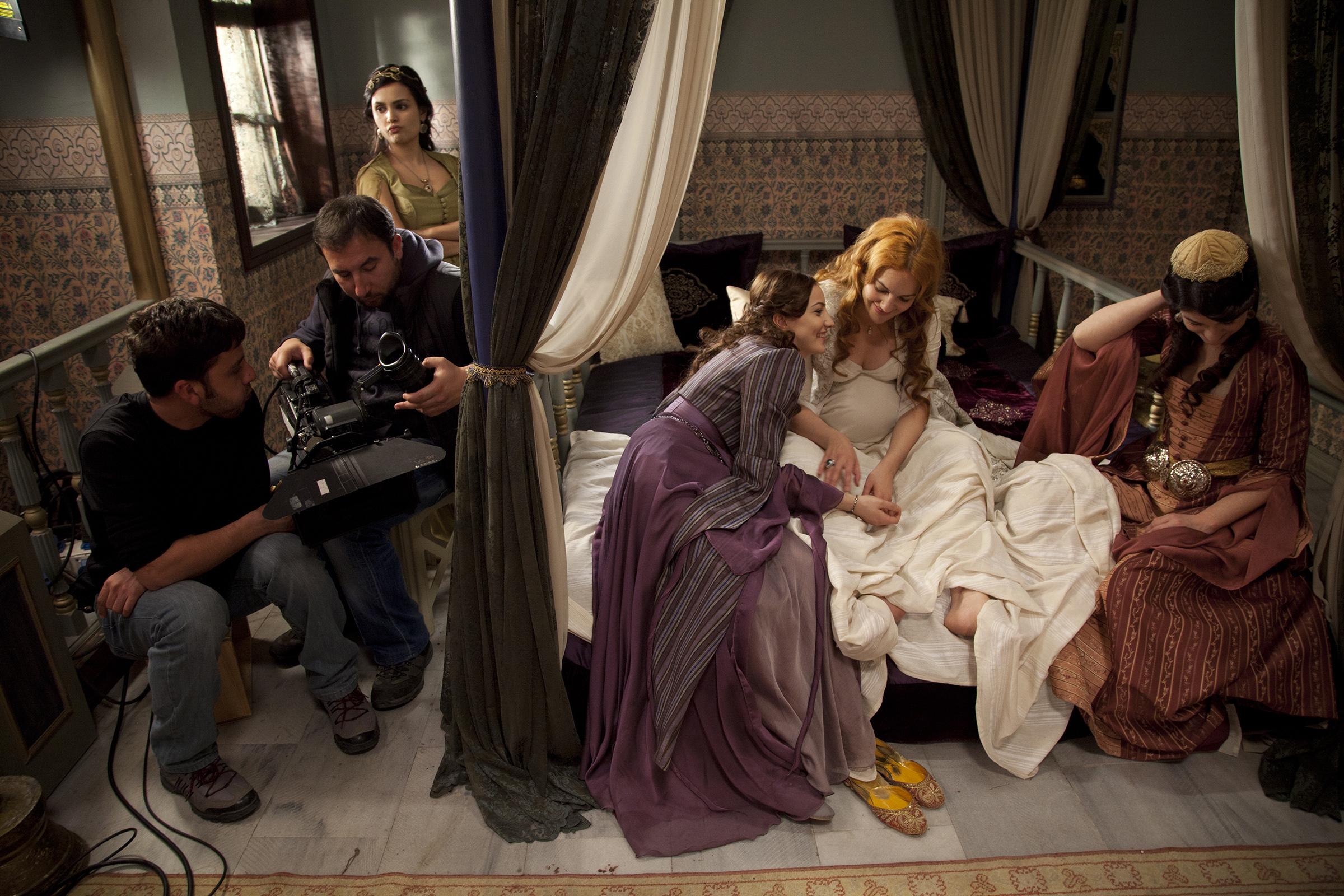 Actress Meryem Uzerli, in white, the main actress on the show  Muhteseni Yuzyil,  or The Magnificent Century, jokes with her colleagues in between takes on the set in Istanbul, Turkey on March 16, 2011.