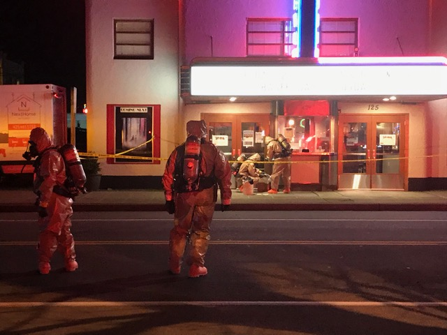Hazmat technicians arrive at North Bend Theatre after it received a package marked 'highly contagious human substance.' It turned out to be urine.