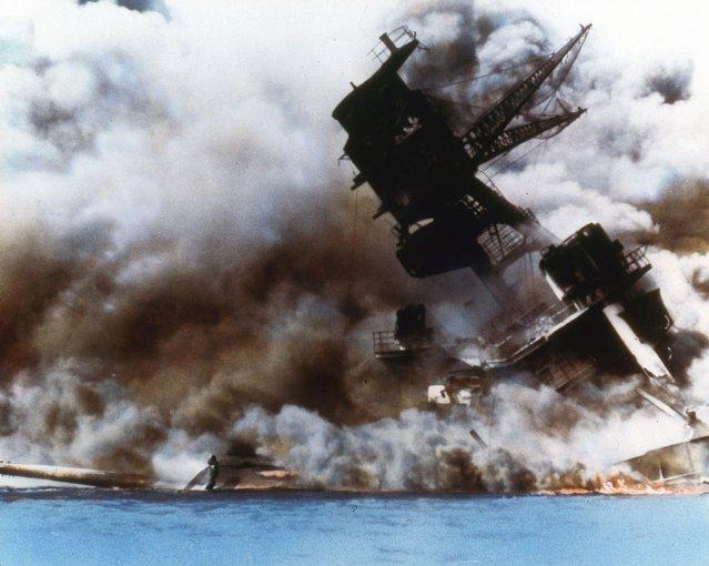 The battleship U.S.S. Arizona burns and sinks after the Japanese attack on Pearl Harbor, Honolulu, Dec. 7, 1941.