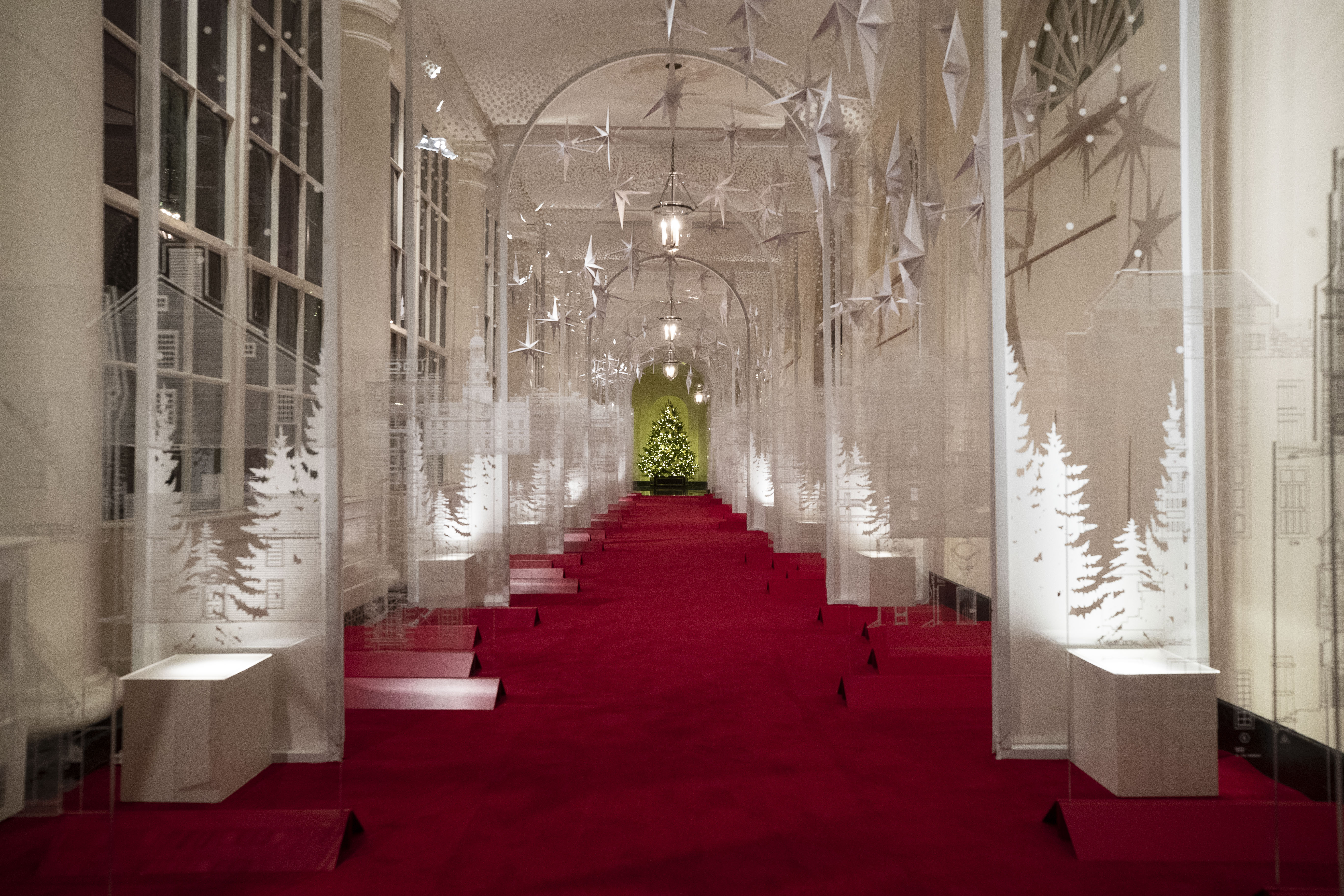 The East Colonnade is decorated with a timeline of American design, innovation and architecture during the 2019 Christmas preview at the White House, Monday, Dec. 2, 2019, in Washington. This year's theme is,  The Spirit of America.