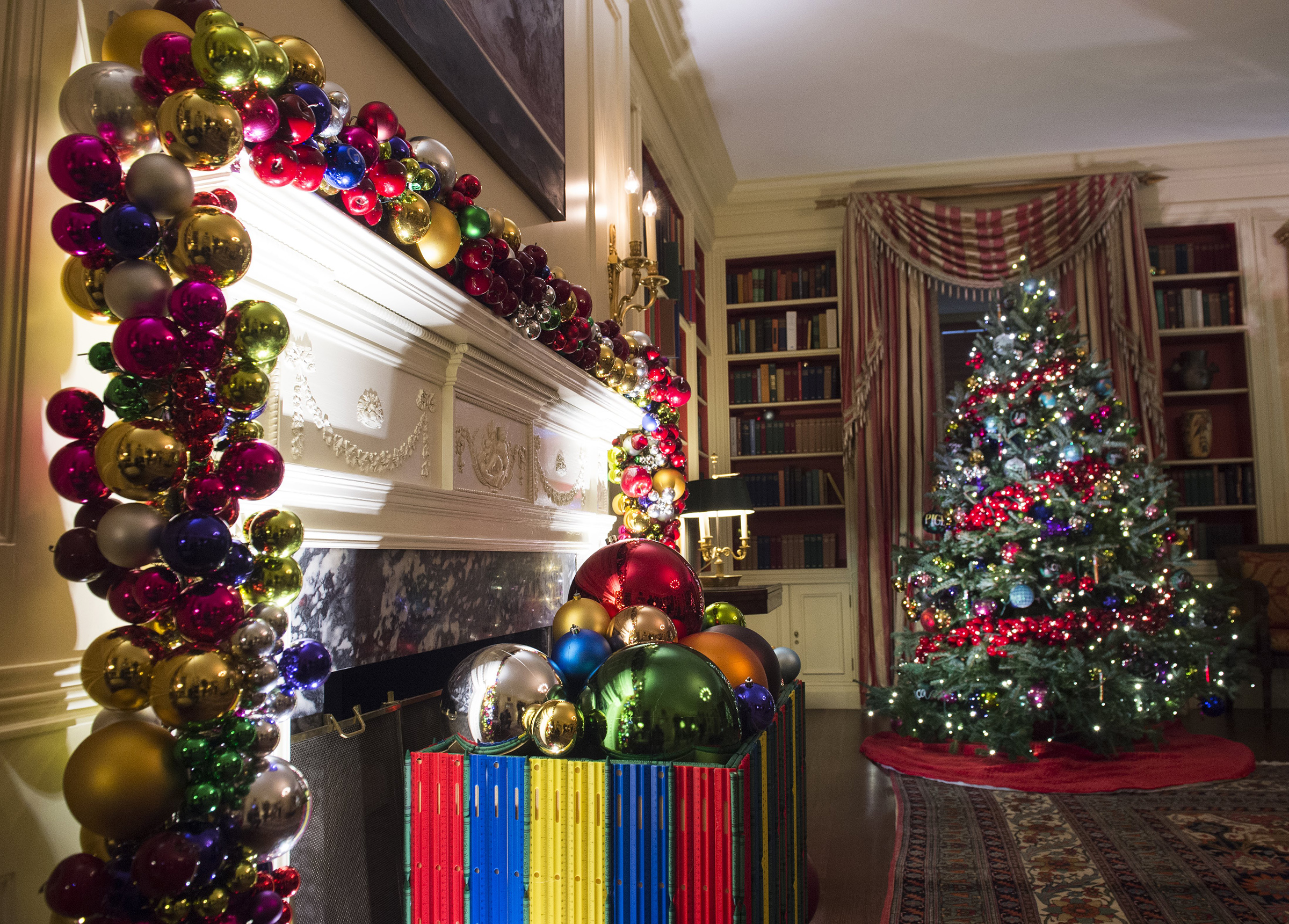 Christmas trees and holiday decorations in the theme of,  The Gift of the Holidays,  are seen in the Library of the White House in Washington, D.c. on Nov. 29, 2016.