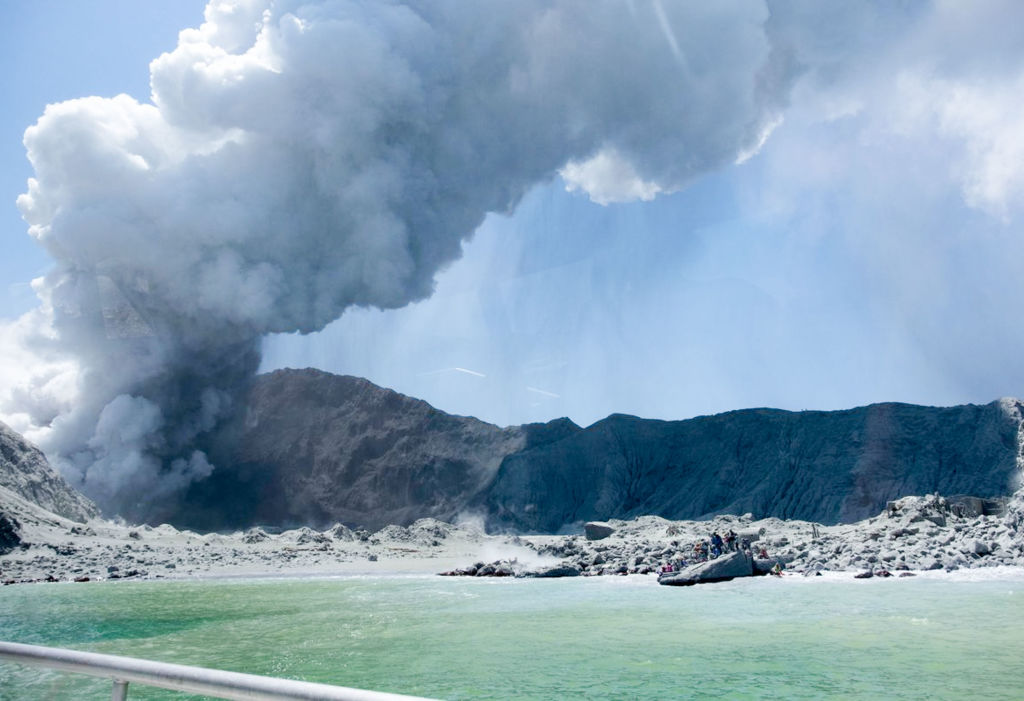A photo taken on Dec. 9, 2019 shows the heavy smoke from a volcanic eruption at New Zealand's White Island.