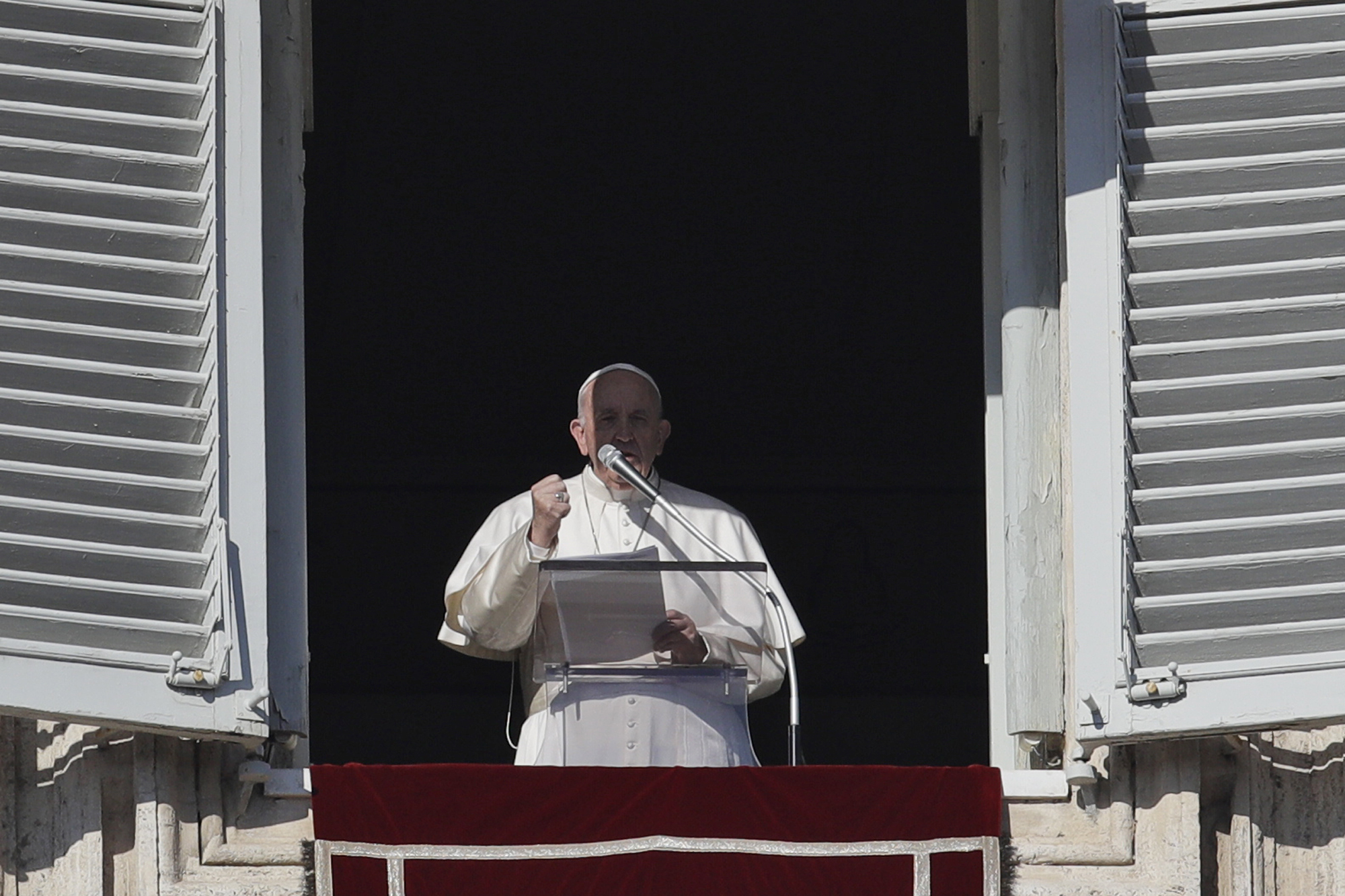 Pope Francis recites the Angelus prayer from his studio's window overlooking St. Peter's square at the Vatican, Wednesday, Jan. 1, 2020.