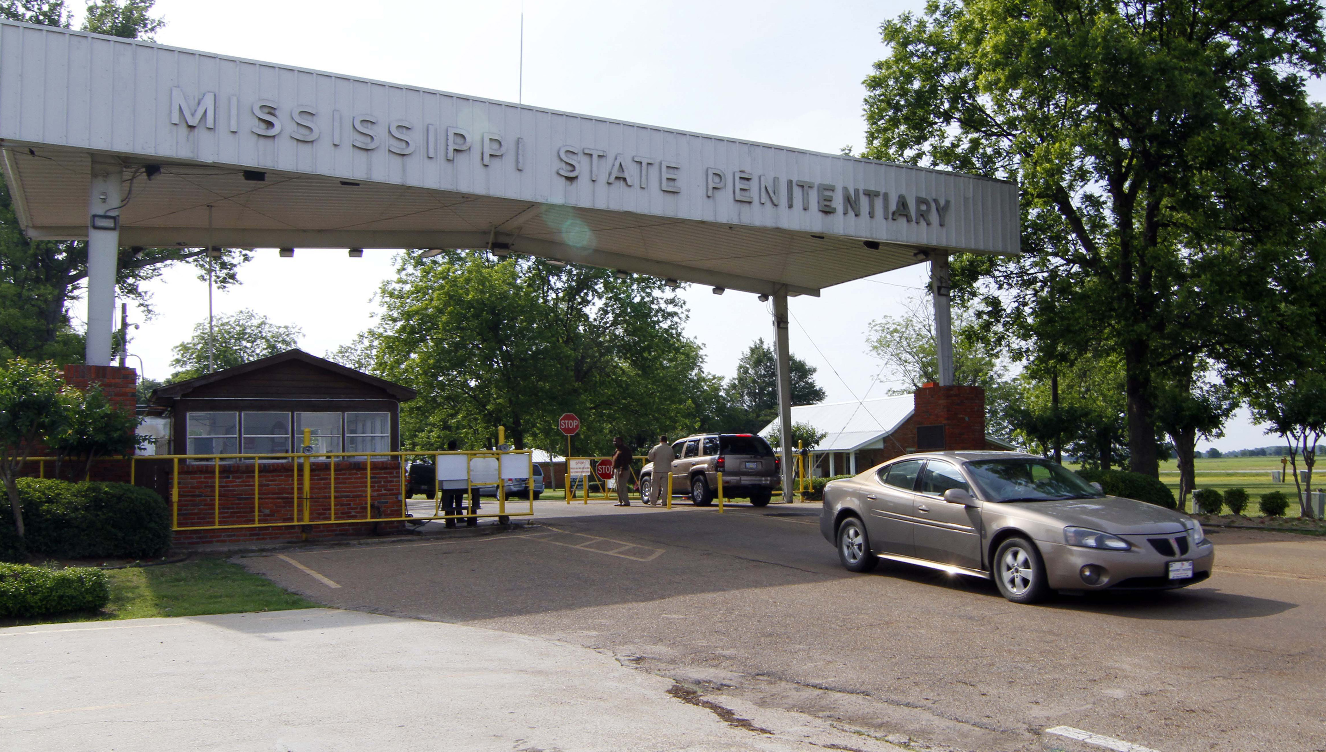 Traffic moves past the front of the Mississippi State Penitentiary in Parchman, Miss. on May 19, 2010. Another Mississippi inmate died at the hands of a fellow inmate on, Jan. 2, 2020, this time, at the penitentiary, bringing the death toll to four amid disturbances over the past week in the state prison system.