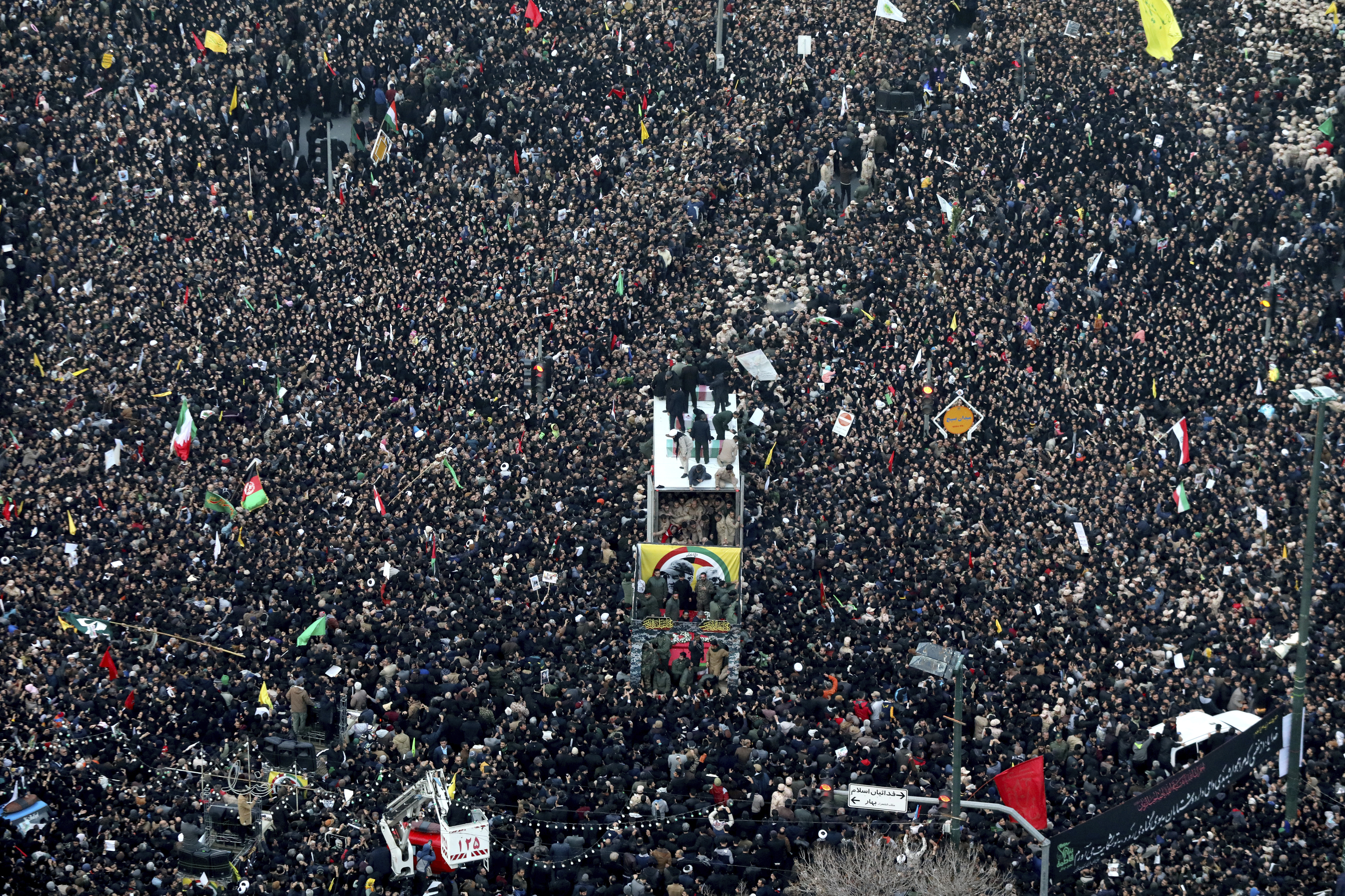 Coffins of Gen. Qassem Soleimani and others who were killed in Iraq by a U.S. drone strike, are carried on a truck surrounded by mourners during a funeral procession, in the city of Mashhad, Iran, on Jan. 5, 2020.