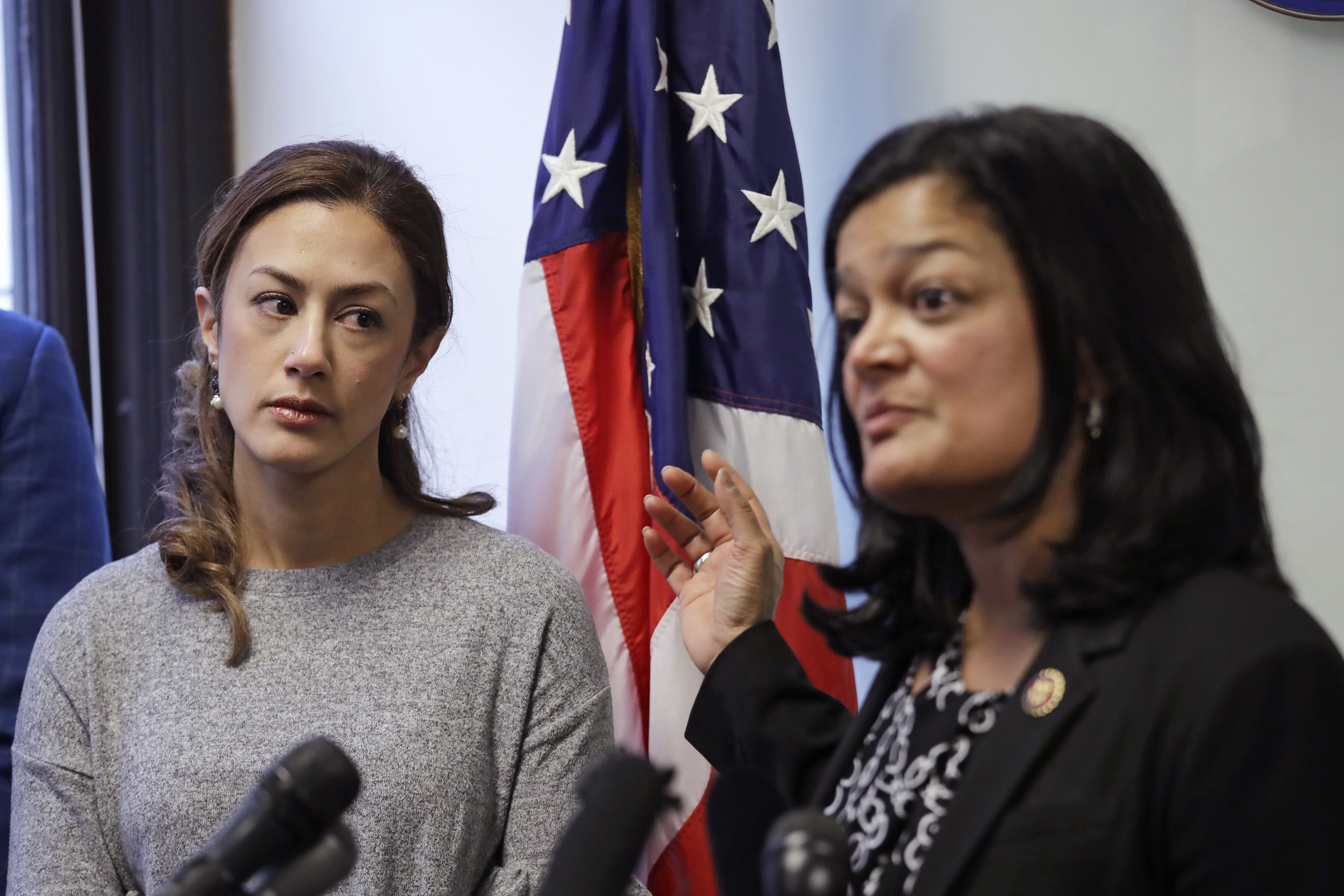 Negah Hekmati, left, looks on as Rep. Pramila Jayapal, D-Wash., addresses a news conference about Hekmati's ordeal during an hours-long delay returning to the U.S. from Canada with her family days earlier, Monday, Jan. 6, 2020, in Seattle.