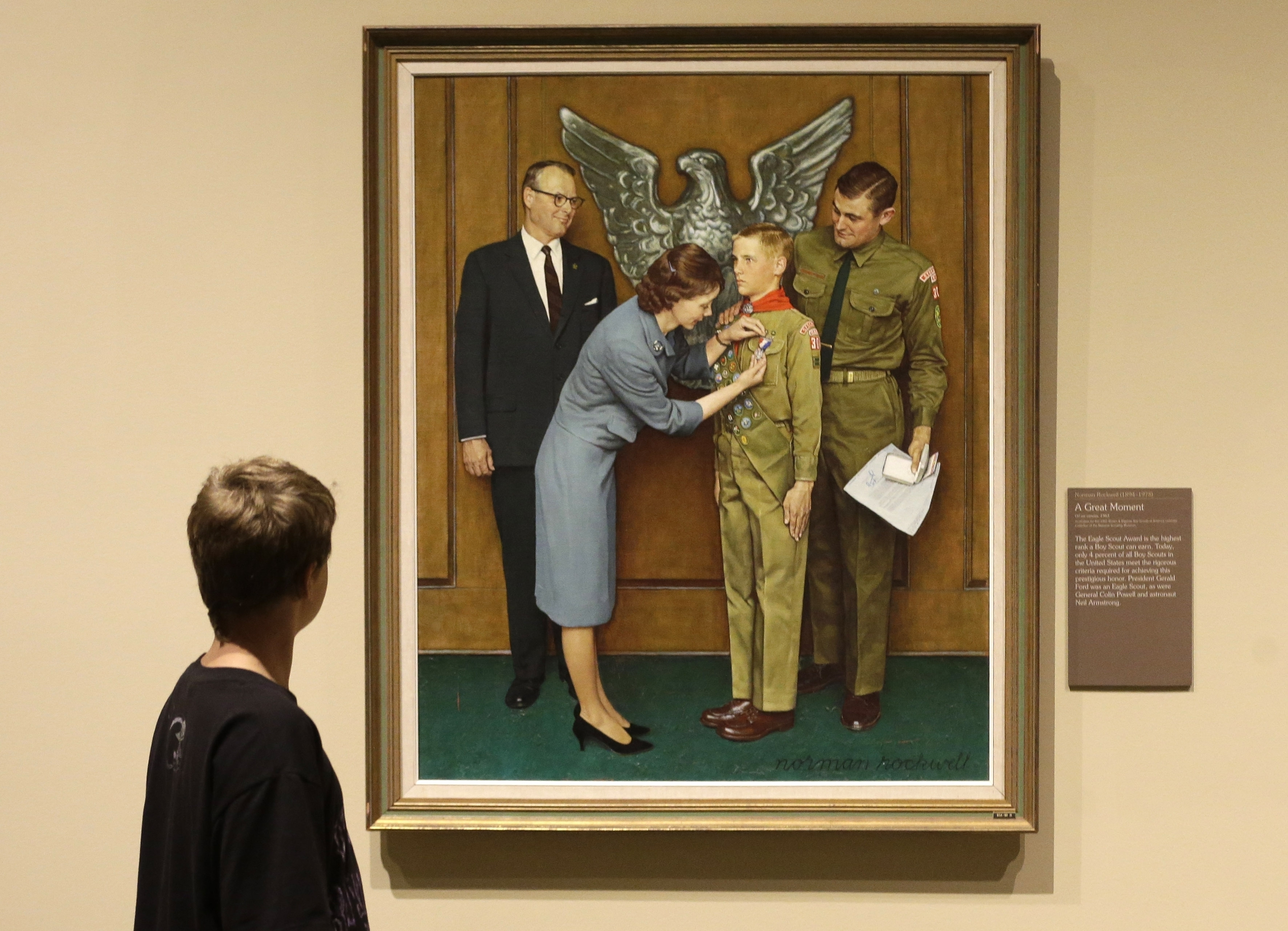 In this July 22, 2013, file photo, a youth looks over the Norman Rockwell exhibition in Salt Lake City, featuring his Boy Scout-themed paintings.
