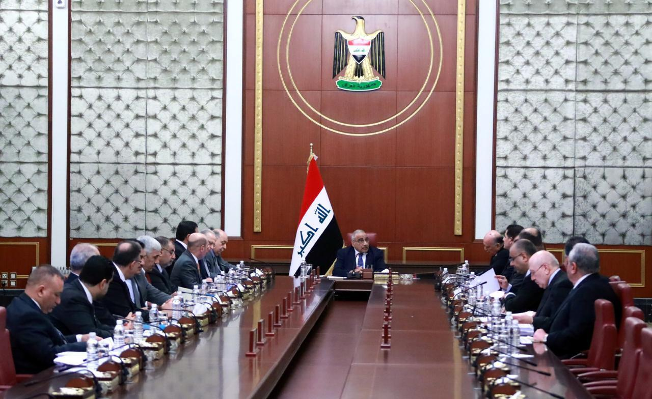 In a photo released by the Iraqi Prime Minister Media Office, Iraqi acting Prime Minister Adil Abdul-Mahdi, center, heads a cabinet meeting at the prime minister's office, in Baghdad, Iraq, on Jan. 7, 2020.
