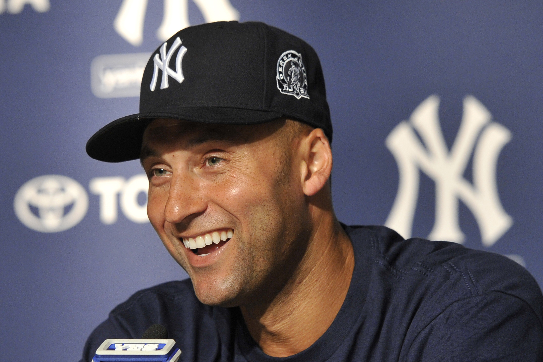 New York Yankees' Derek Jeter smiles as he speaks about his 3,000th career hit at a press conference after a baseball game against the Tampa Bay Rays, at Yankee Stadium in New York, N.Y., on July 9, 2011.