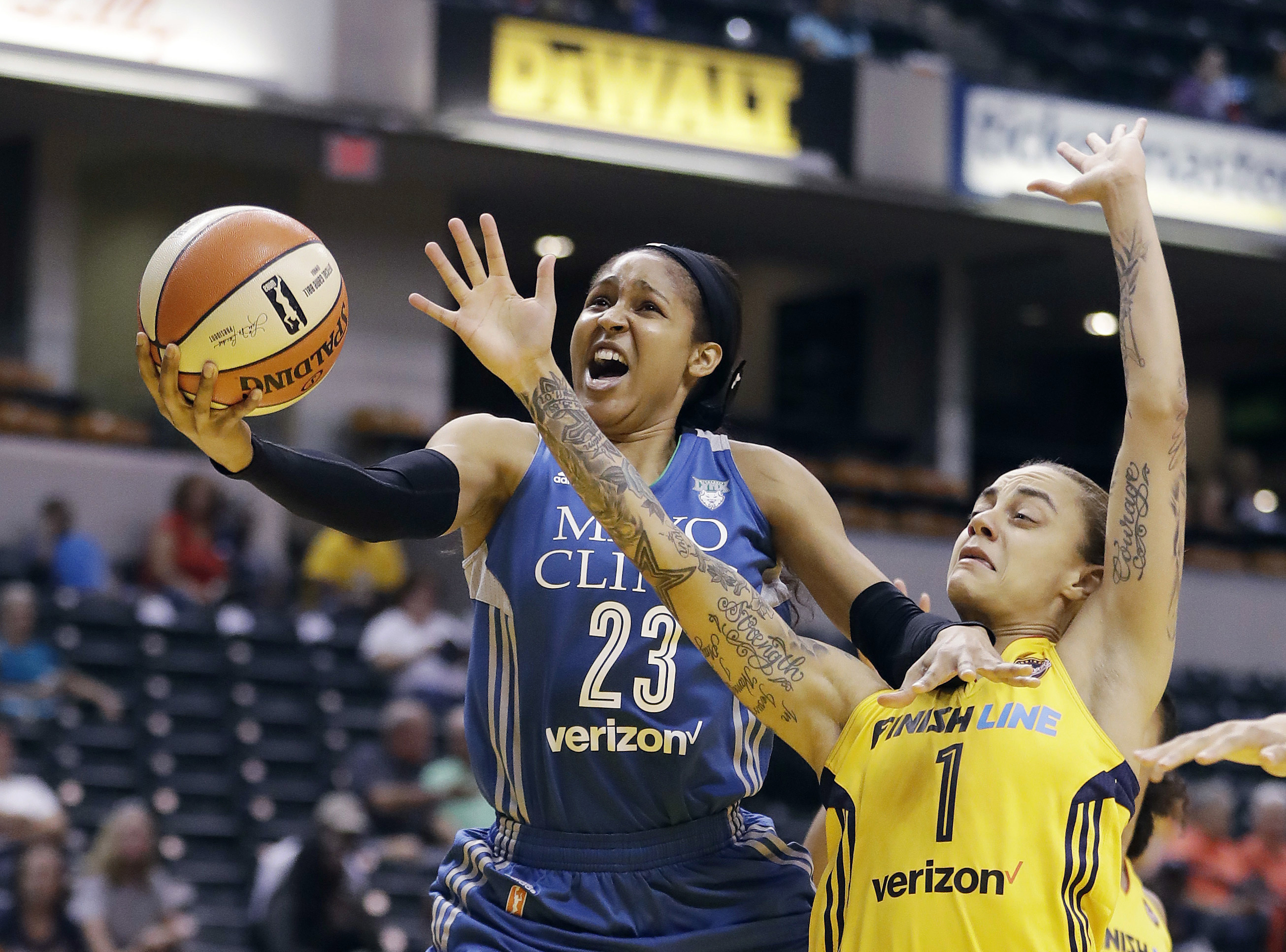 FILE - In this Aug. 30, 2017, file photo, Minnesota Lynx's Maya Moore, left, shoots against Indiana Fever's Jazmon Gwathmey during the first half of a WNBA basketball game in Indianapolis. Moore will sit out a second straight WNBA season in 2020 to continue her push for criminal justice reform.