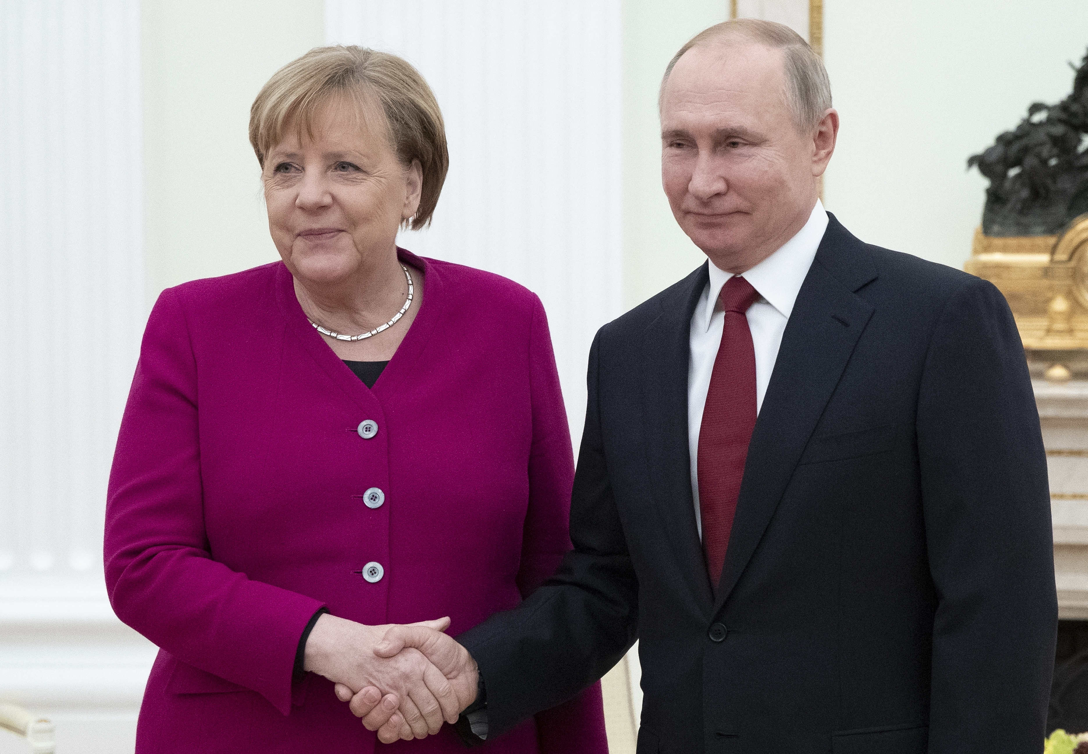 Russian President Vladimir Putin, right, and German Chancellor Angela Merkel pose for a photo prior to the talks in the Kremlin in Moscow, Russia, on Jan. 11, 2020.
