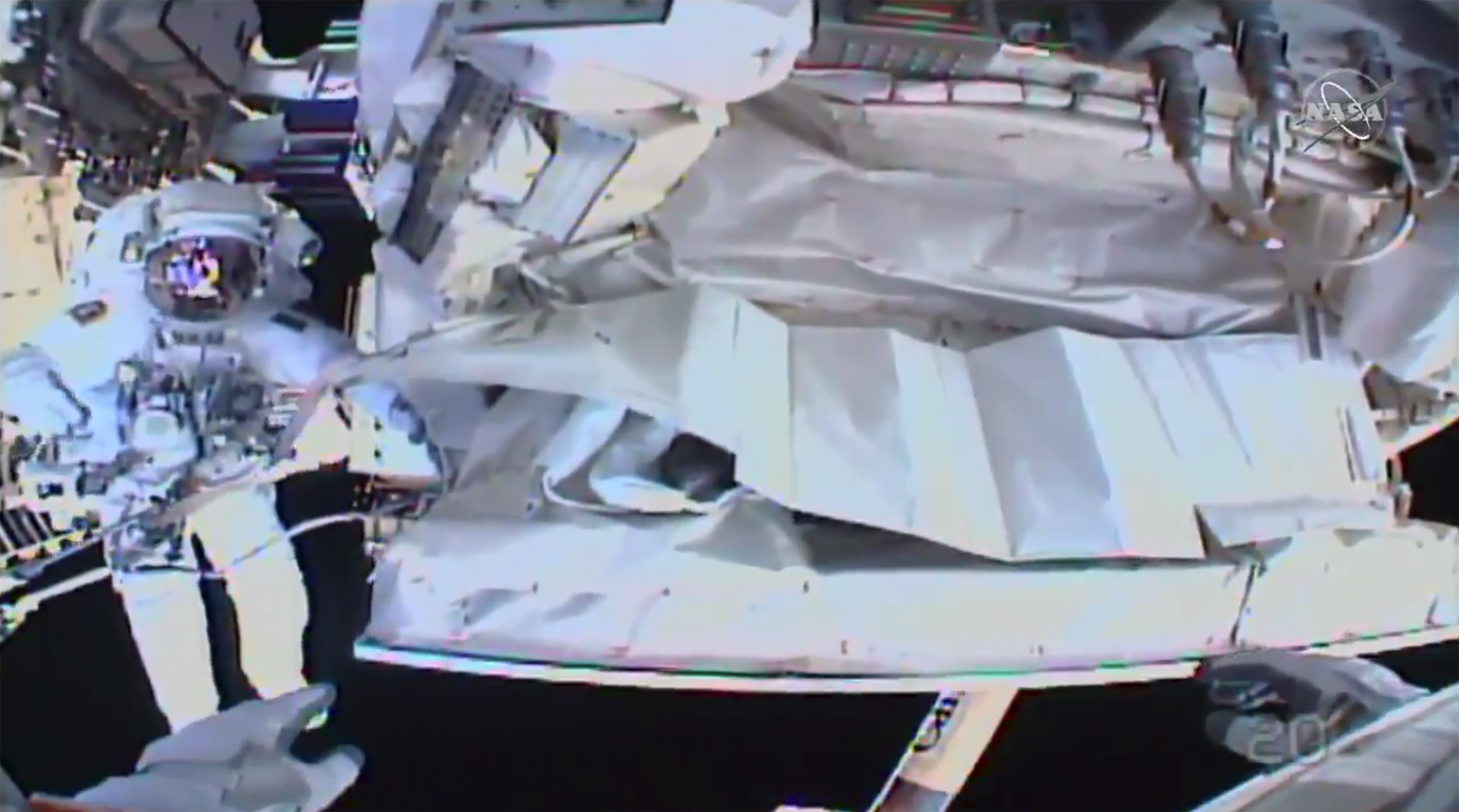 This photo provided by NASA shows the view from NASA's Andrew Morgan's helmet cam as Italian astronaut Luca Parmitano works outside the International Space Station during a spacewalk on Jan. 25, 2020.