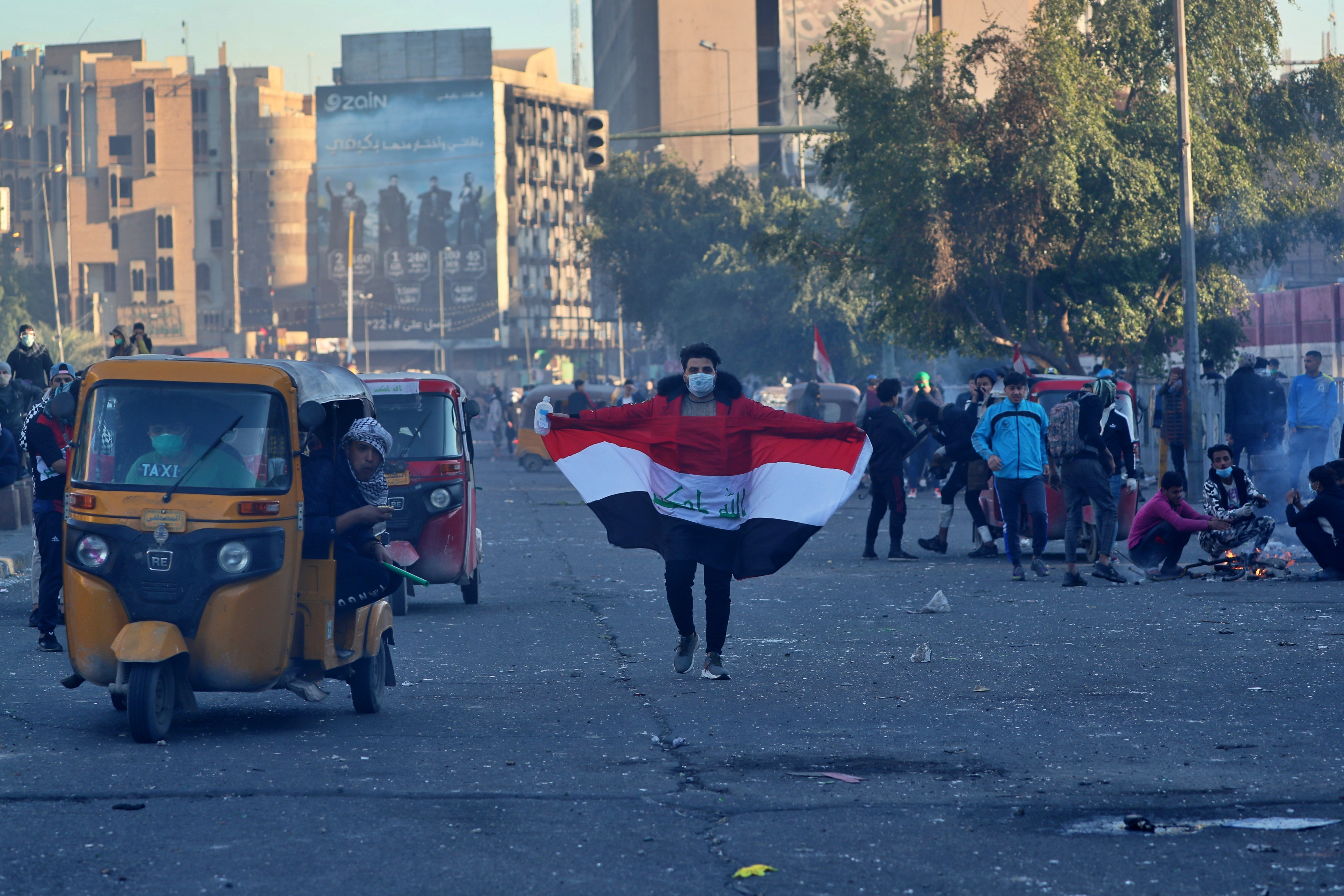 Anti-government protesters close Baghdad's Khilani square during clashes with security forces, Iraq, Sunday, Jan. 26, 2020.