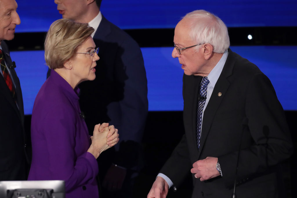 Sen. Elizabeth Warren (D-MA) and Sen. Bernie Sanders (I-VT) speak after the Democratic presidential primary debate at Drake University on January 14, 2020 in Des Moines, Iowa.  Six candidates out of the field qualified for the first Democratic presidential primary debate of 2020, hosted by CNN and the Des Moines Register.