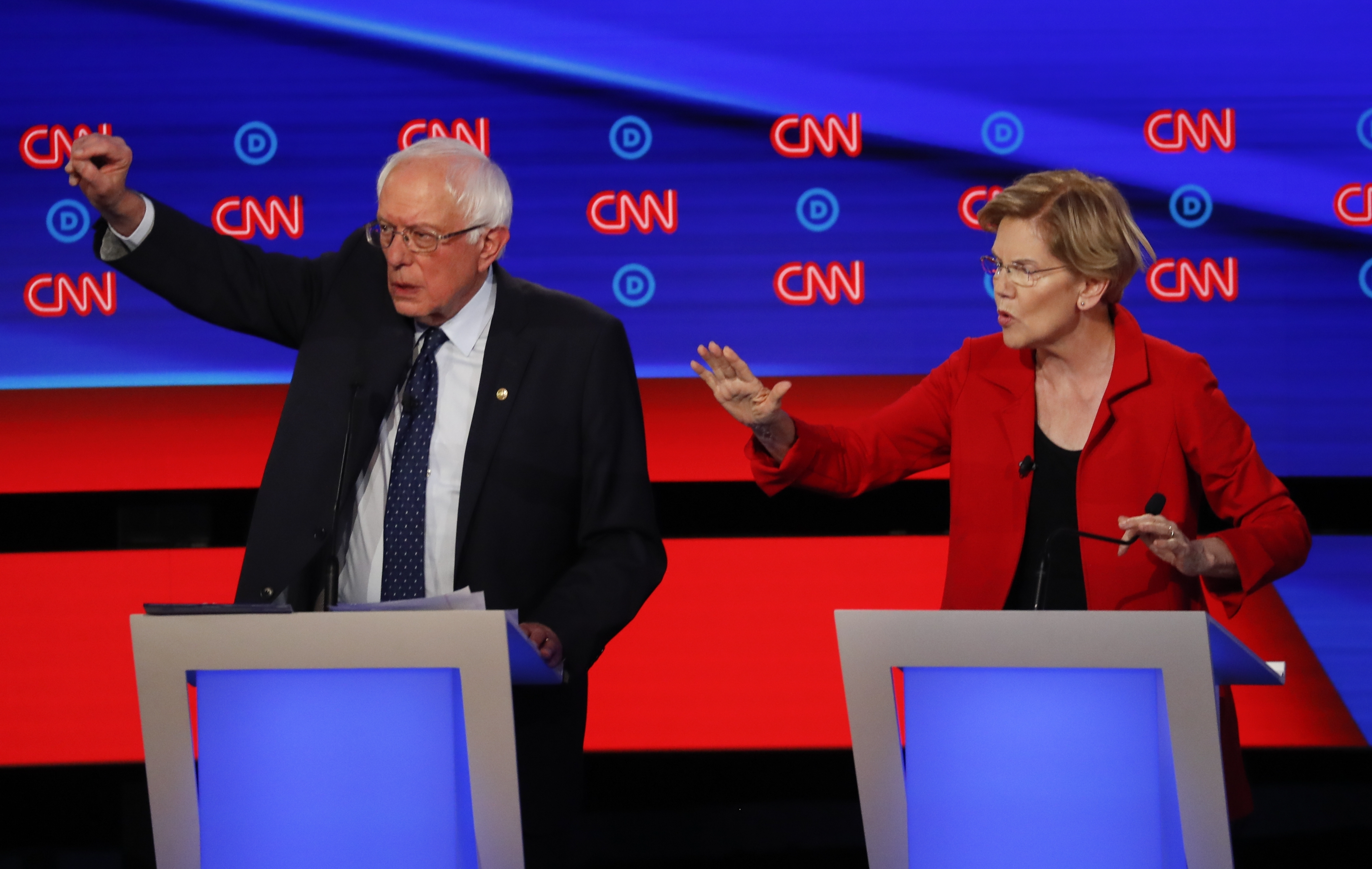 Sen. Bernie Sanders has denied an allegation from Sen. Elizabeth Warren that he told her in 2018 that a woman couldn't win the White House. They are seen together in the July 30, 2019 Democratic primary debate.