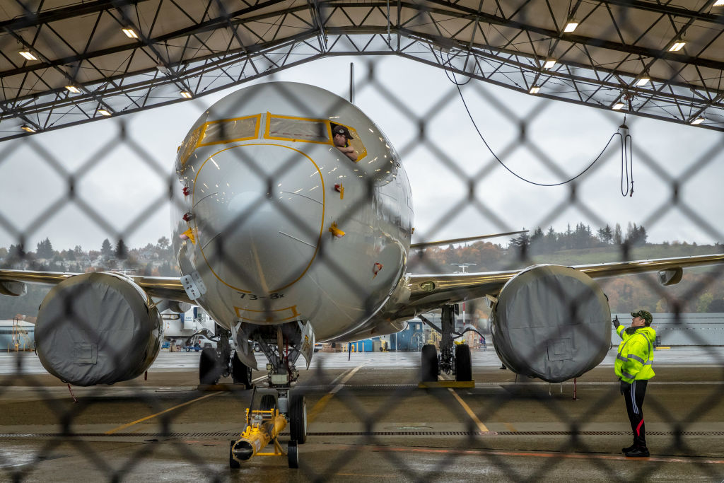 Workers inspect a Boeing 737 MAX aircraft owned by American Airlines at Boeing's Renton Factory on October 20, 2019 in Renton, Washington.