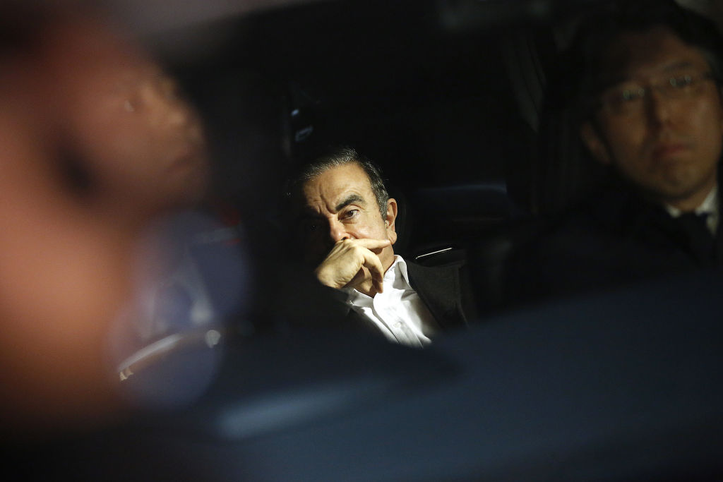 Carlos Ghosn, former chairman of Nissan Motor Co., center, sits in a vehicle as he leaves his lawyer's office in Tokyo, Japan, on March 6, 2019.