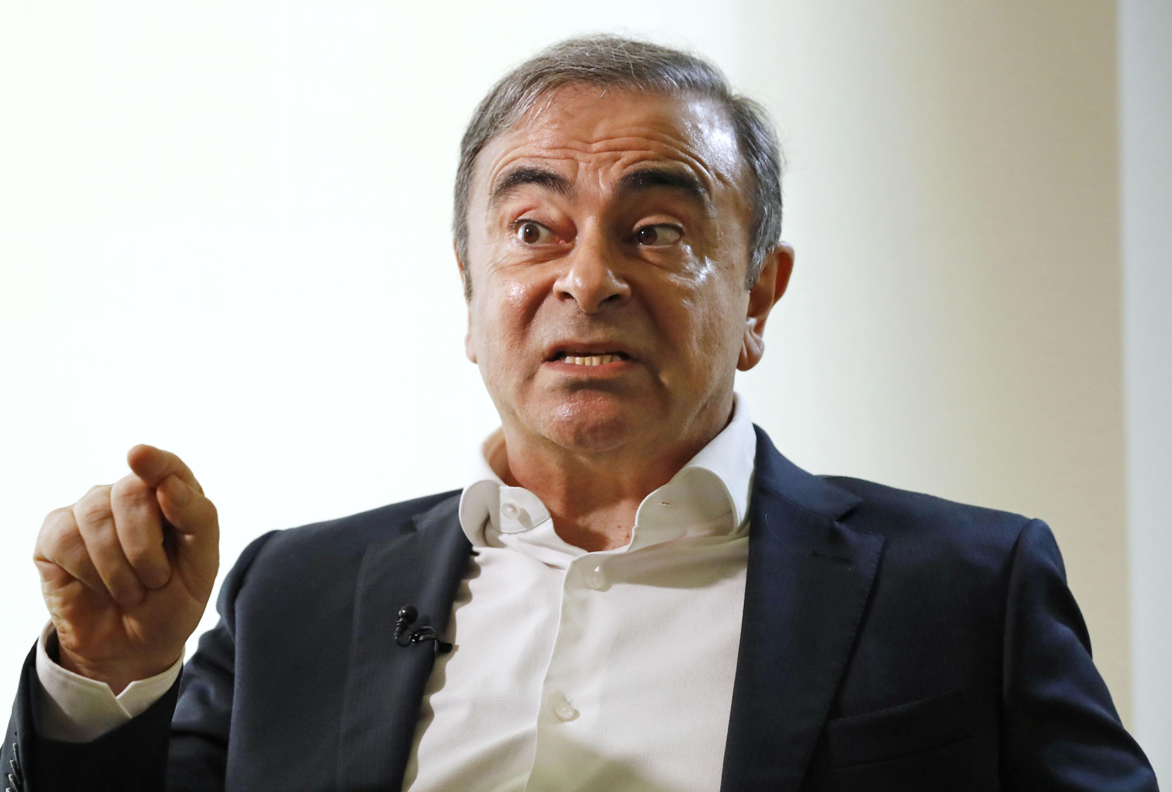 Former Nissan Chairman Carlos Ghosn speaks to Japanese media during an interview in Beirut, Lebanon, on Jan. 10, 2020.