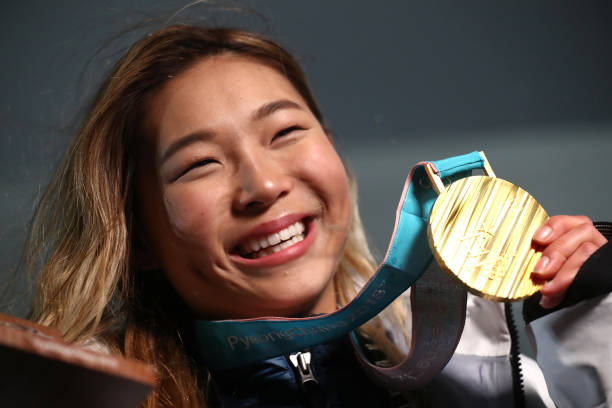 Gold medalist Chloe Kim of the United States poses during the medal ceremony for the Snowboard Ladies' Halfpipe Final on day four of the PyeongChang 2018 Winter Olympic Games at Medal Plaza in PyeongChang, South Korea on February 13, 2018.