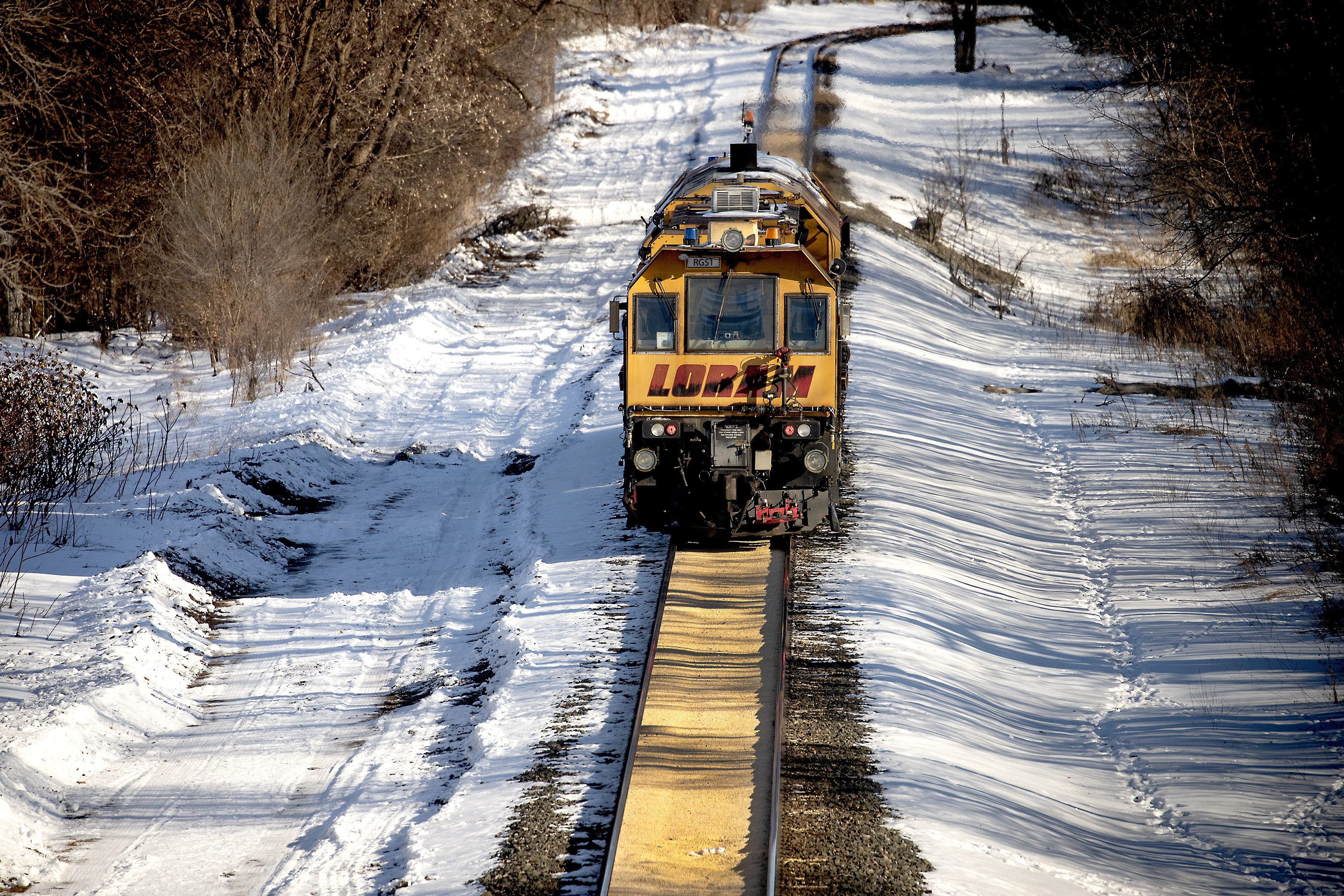 A train makes its way along a path where corn spilled from a train on a Canadian Pacific line and sat two inches deep for just under a half-mile on Jan. 7, 2020 in Crystal, Minn.