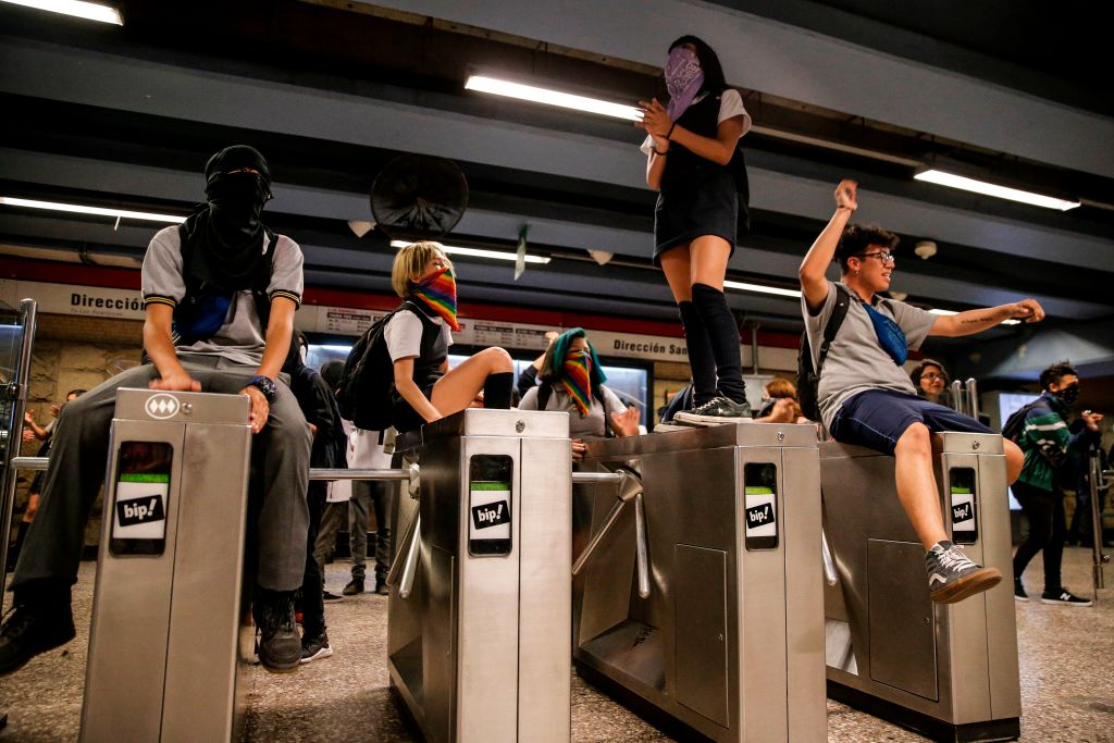 Students demonstrate at Los Heroes metro station during a mass fare-dodging protest in Santiago, Chile, on December 02, 2019.