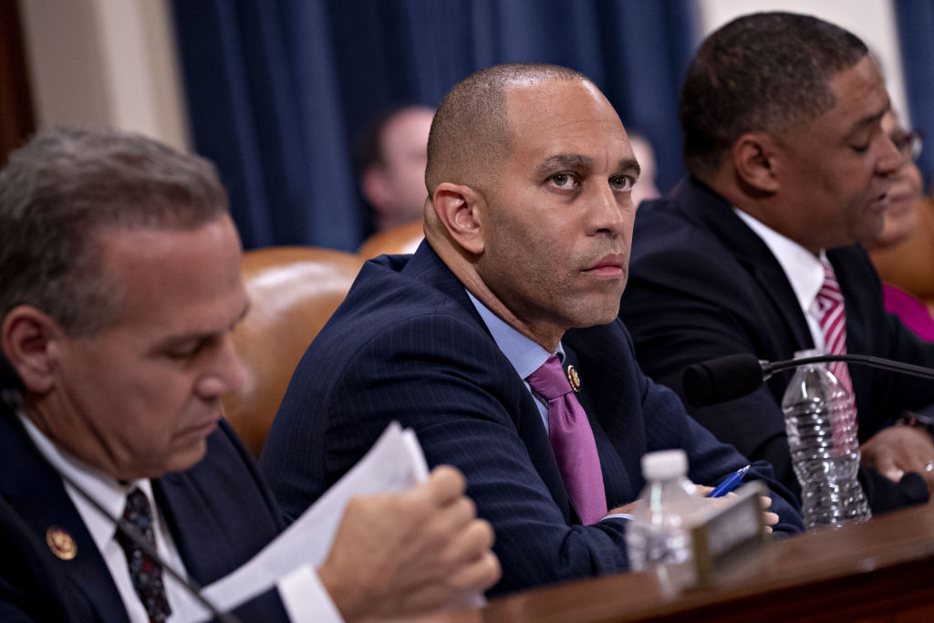 Representative Hakeem Jeffries, a Democrat from New York and chair of the Democratic Caucus, center, listens during a House Judiciary Committee impeachment inquiry hearing in Washington, D.C., Dec. 4, 2019.
