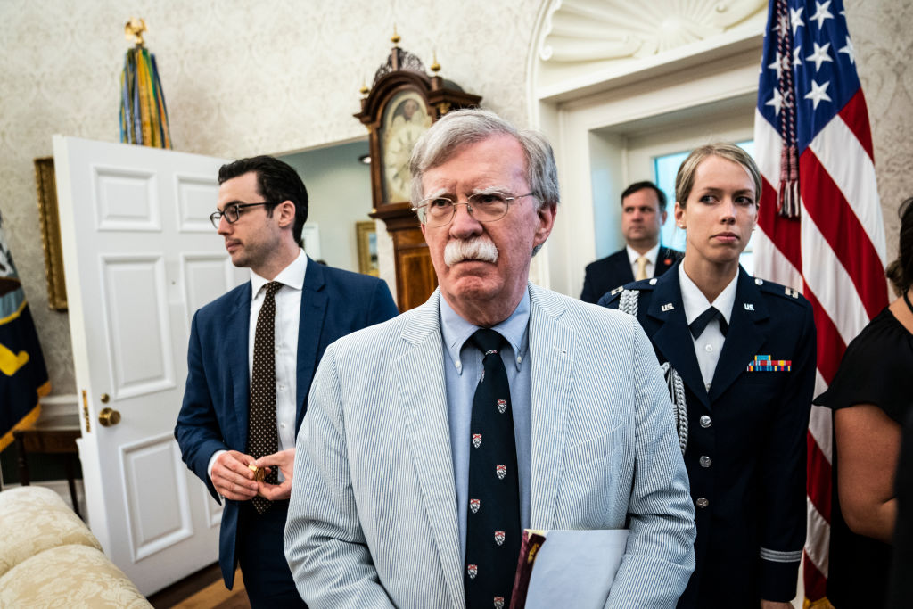 Then National Security Advisor John R. Bolton listens as President Donald J. Trump and First Lady Melania Trump meet with Buzz Aldrin, Michael Collins, and the Family of Neil Armstrong in celebration of the 50th anniversary of the Apollo 11 Moon landing at the White House in Washington, DC, on July 19th, 2019.