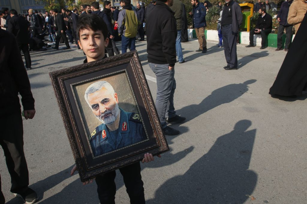 A boy holds a portrait of Iranian Revolutionary Guards Major General Qasem Soleimani during a demonstration in Tehran on Jan. 3, 2020 against the killing of the top commander in a US strike in Baghdad