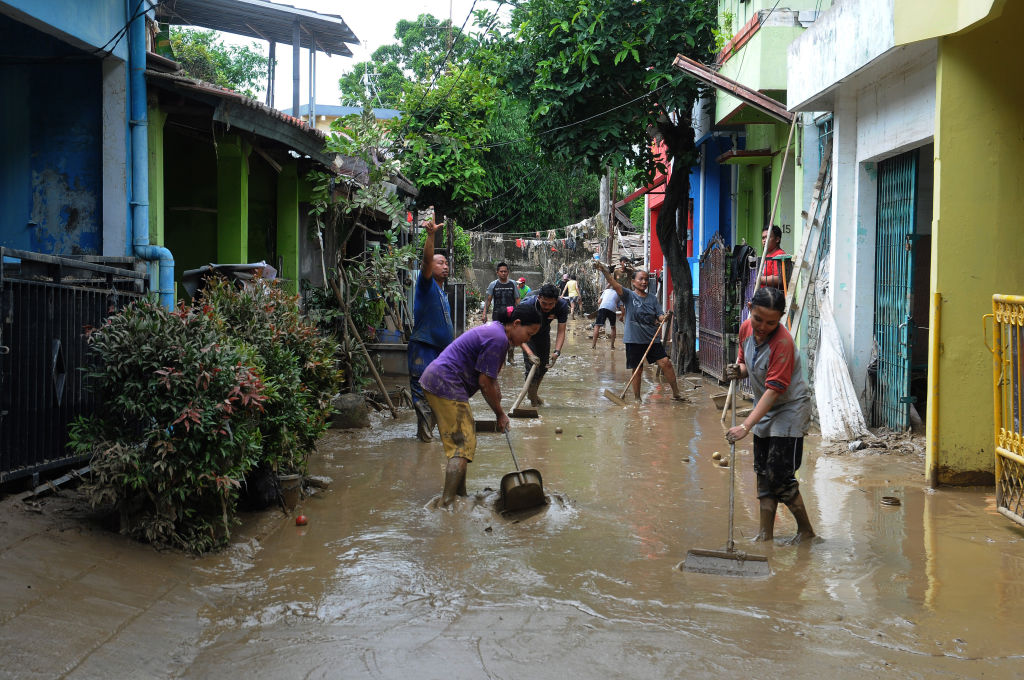 Residents began cleaning mud and furniture affected by floods as high as 5 meters in the residential Pondok gede permai, Bekasi, West Java, Jan. 4,2020.