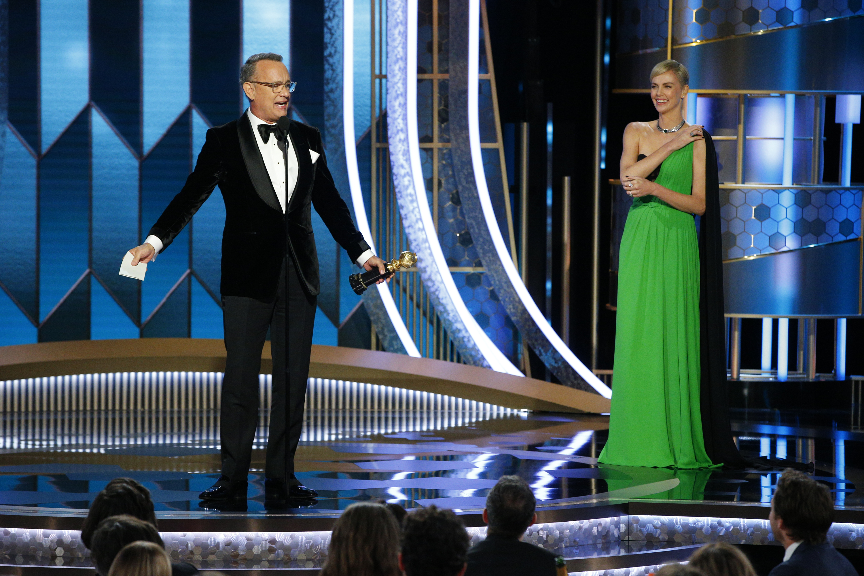 Tom Hanks accepts the Cecil B, DeMille Award, presented by Charlize Theron, onstage during the 77th Annual Golden Globe Awards on Jan. 5, 2020 in Beverly Hills, Calif.